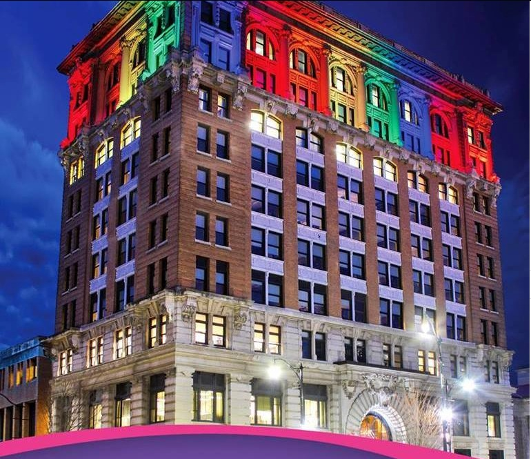 Security Mutual Life Insurance Building lit up for Sock Out Cancer