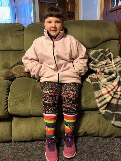 Little girl wearing Sock Out Cancer socks