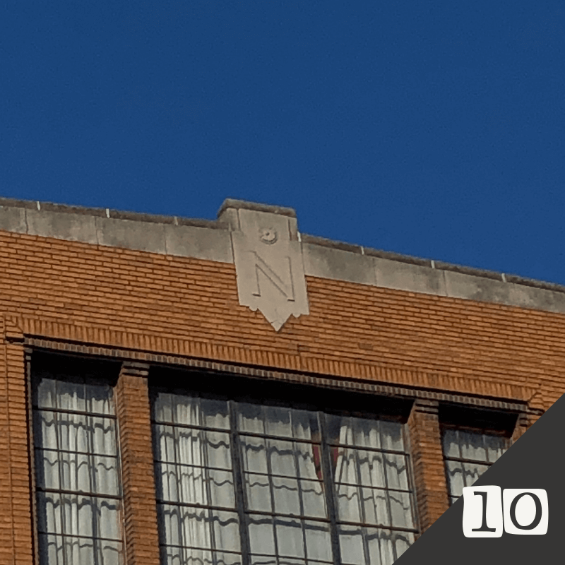 """The Newman Building (1930) 1293 W. 9th Street   An alteration done in 1930 of a previous structure, the upper floors include a newer cornice and medallion. The """"N"""" stands for the company that commissioned the work - the Newman Manufacturing Company dealt in toys, novelties, and party goods."""