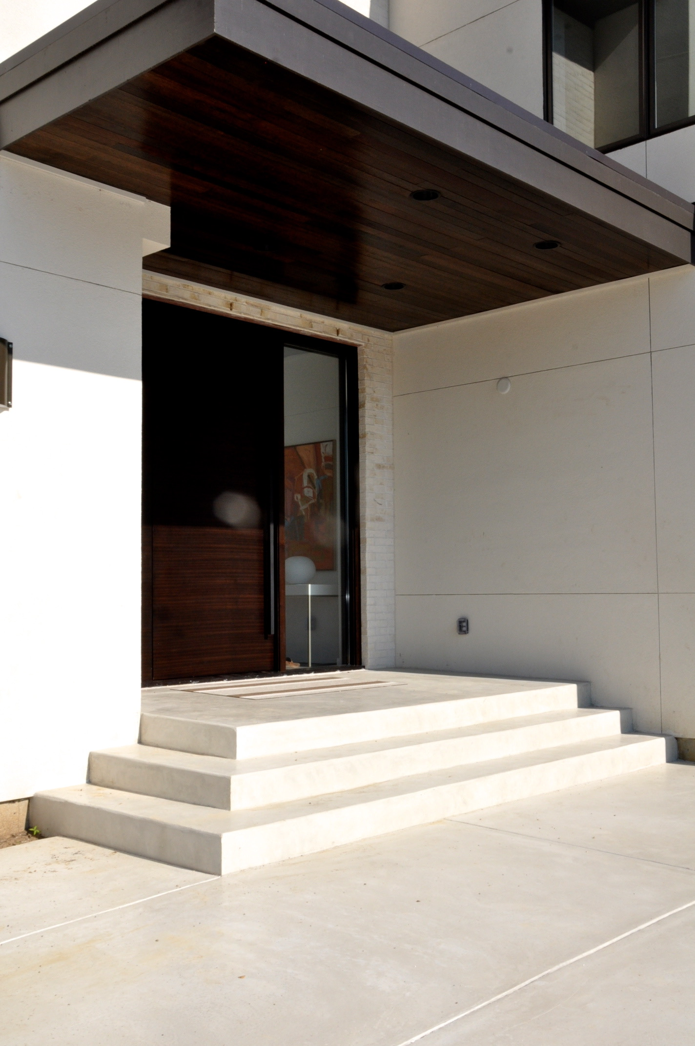 whit dyed smooth finish concrete landing, steps, front courtyard.jpg
