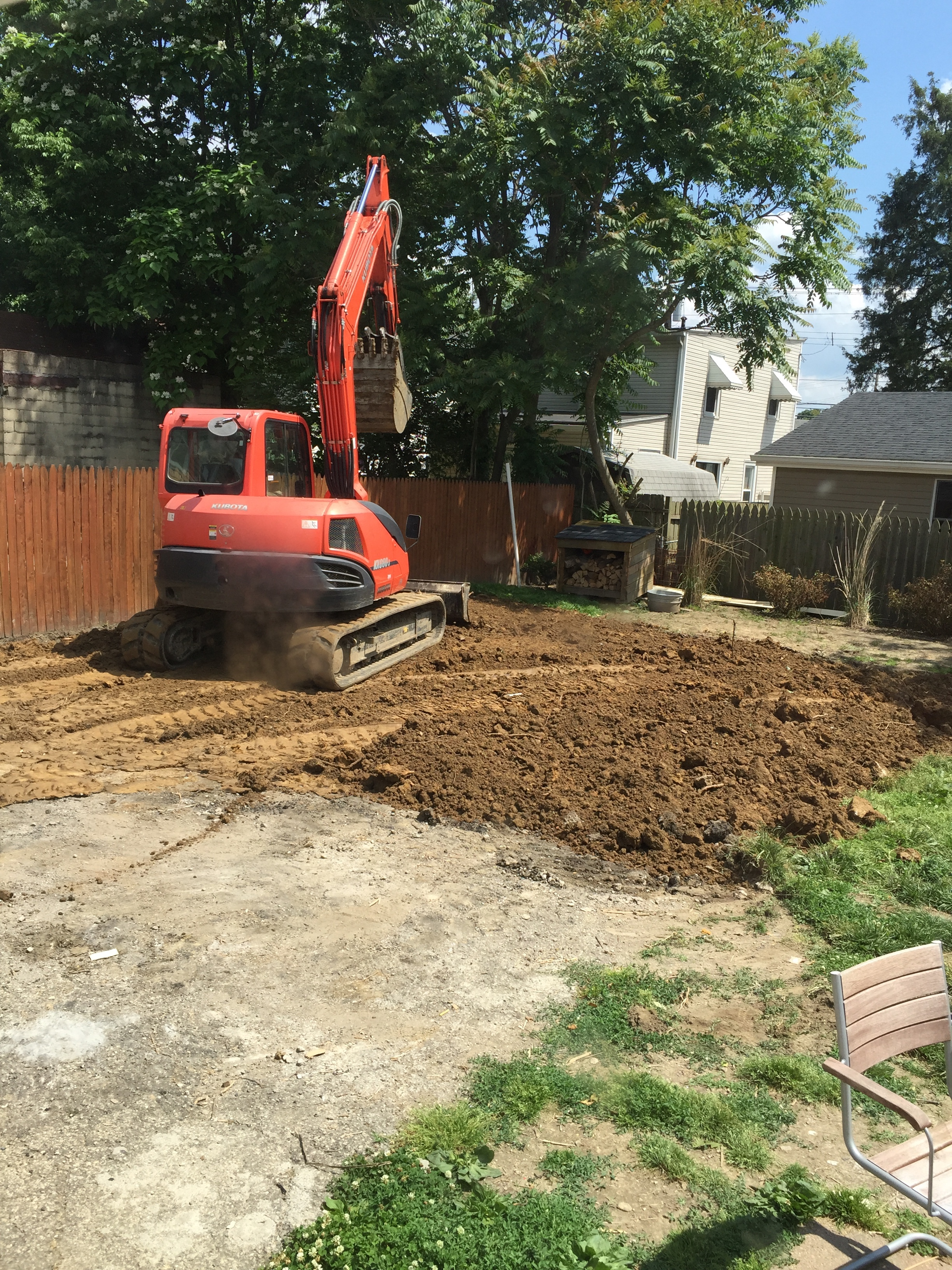 kubota grading back yard:removal of rear blacktop.JPG