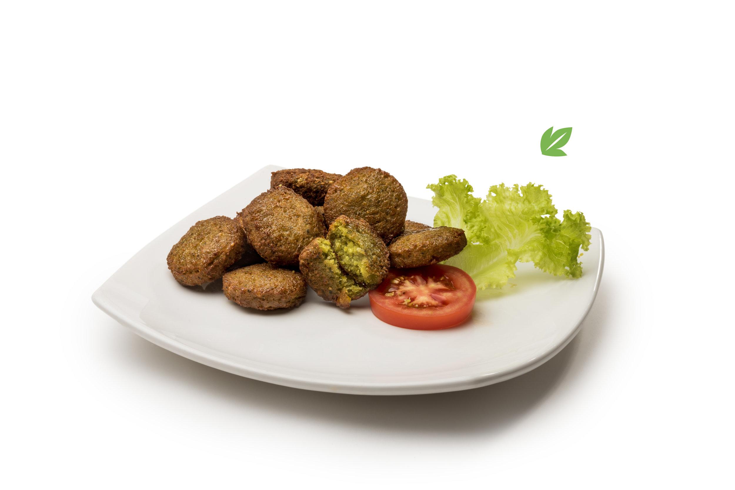 Falafel - Mini croquetas fritas de garbanzo procesado con hierbas. Porción de 8 unidades, acompañado con guarnición.$290