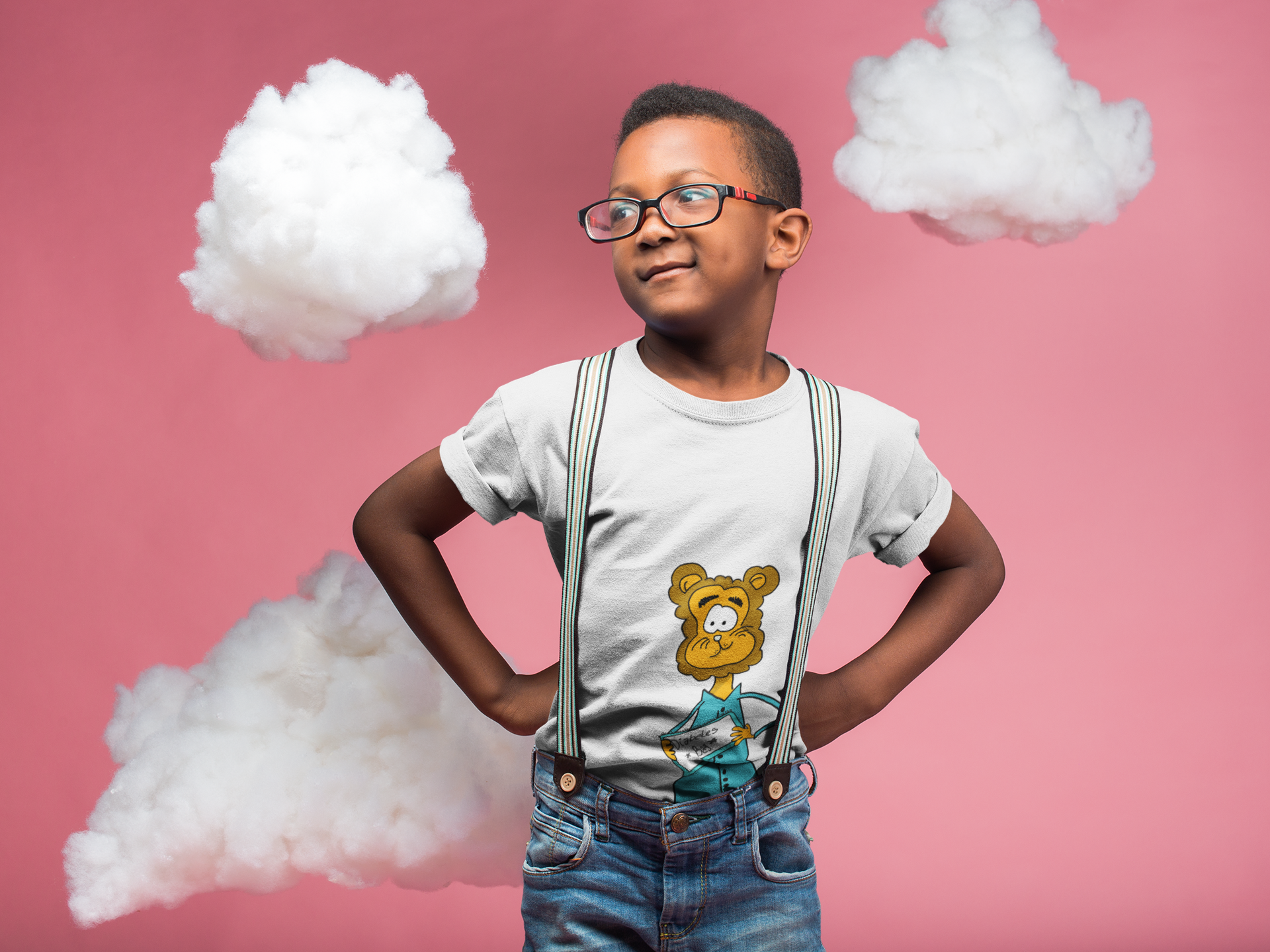 black-kid-wearing-a-t-shirt-mockup-and-glasses-while-standing-in-a-pink-room-with-clouds-a19727.png