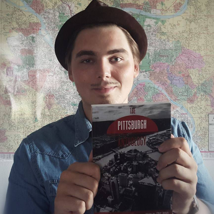 Eric in 2015 with a copy of the anthology I edited for  Rust Belt Chic & Belt Magazine .