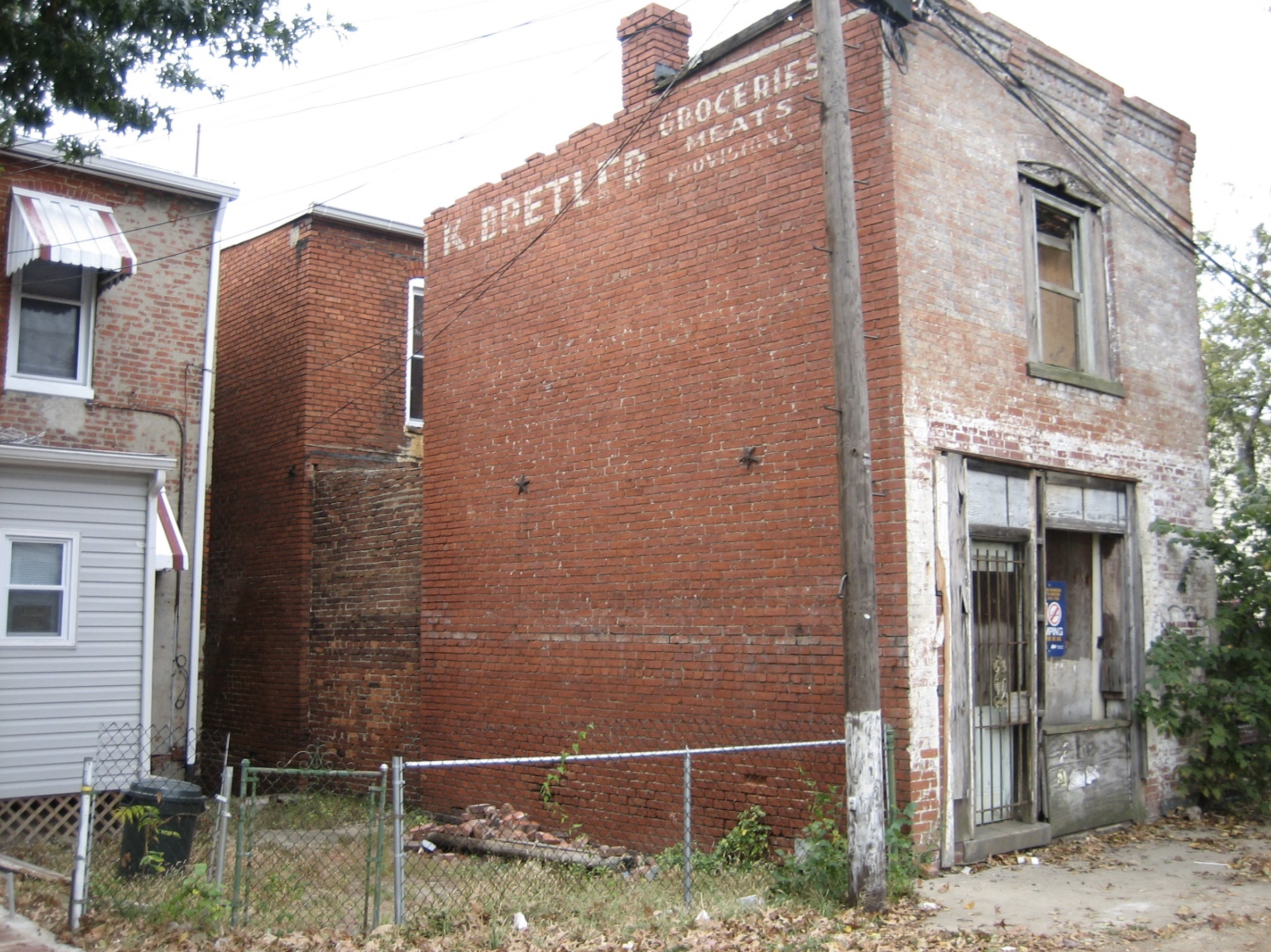 Butcher Shop Grocery Store on Capital Hill Renovation Brick Building Before Photo