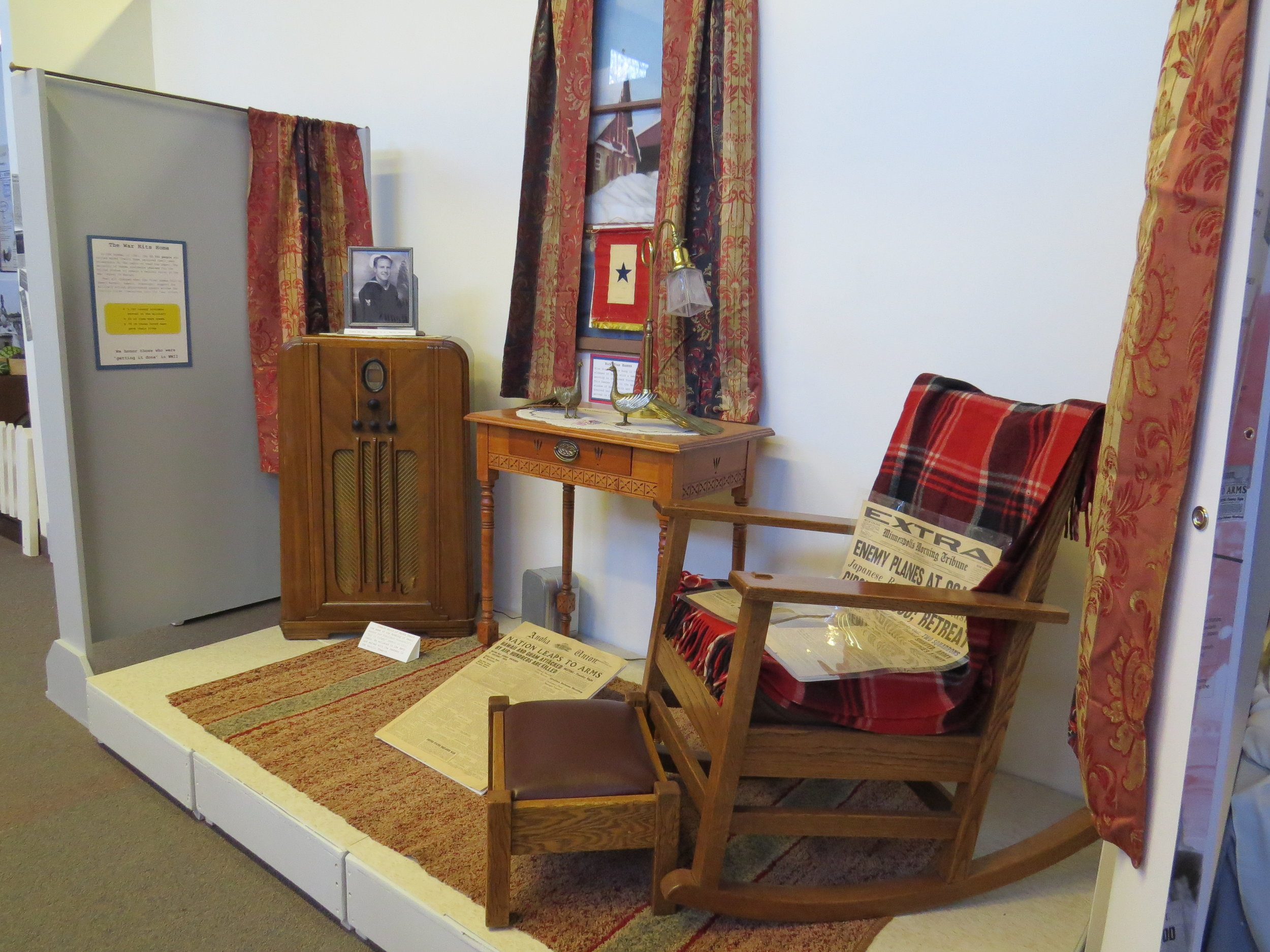 """Family living space vignette in the """"Getting it Done: Anoka County's Answer to WWII"""". On display now through July, 2019."""
