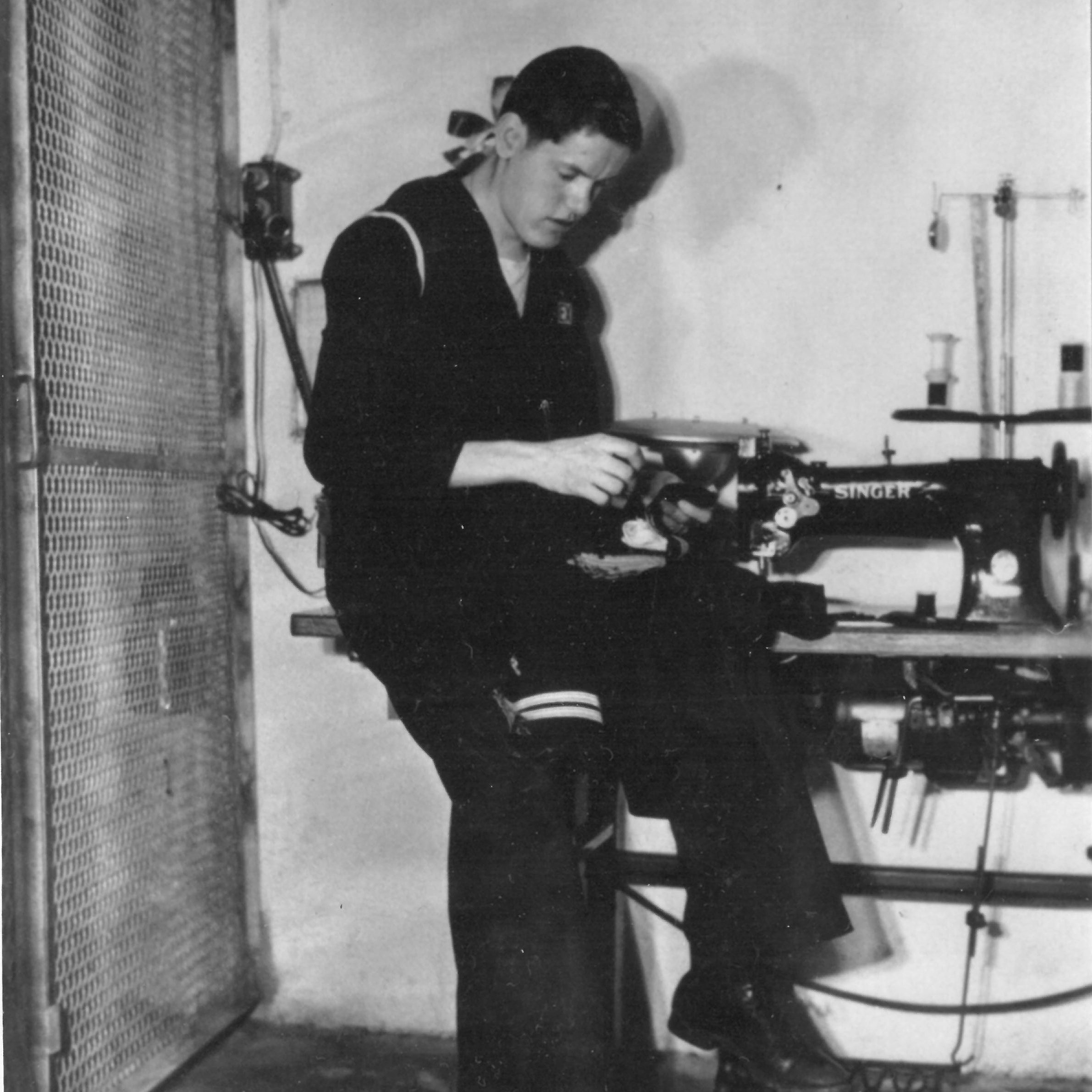 Lindstrom on board the  Alabama  with his sewing machine.