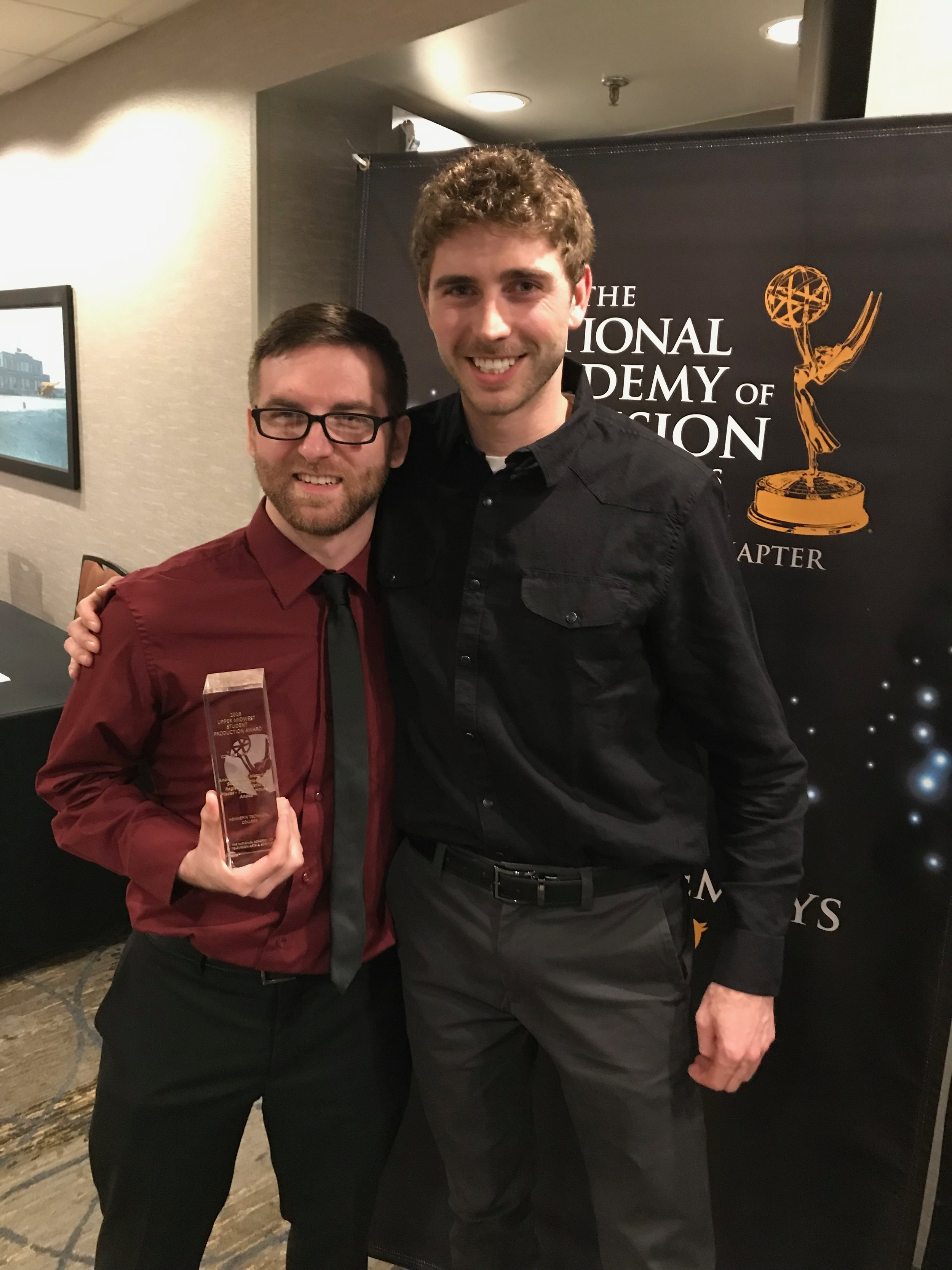 Justin Ramey, left, received a Crystal Pillar Award for a video about the Ticknor House Bed and Breakfast. Charles Ellingson, right, produced a video about the Carlos Avery Game Farm that was a Crystal Pillar runner-up. The videos were produced as part of a collaboration between Hennepin Technical College and the Anoka County Historical Society. (Photo courtesy of the Anoka County Historical Society)
