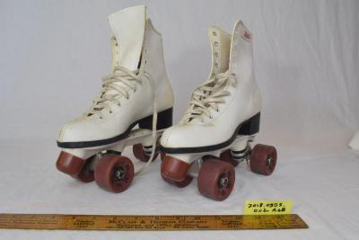 White roller skates with pink wheels and white laces, ca. late 1960s.  (object ID 2018.0995.002)