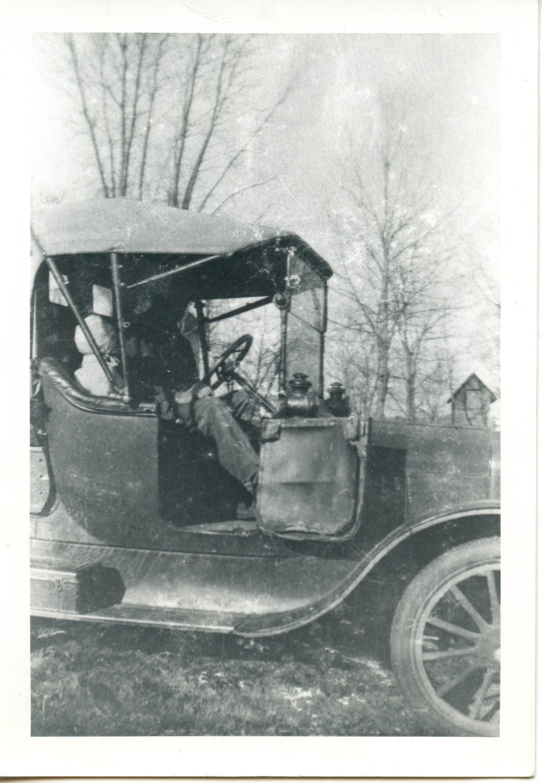 Leonard Weber in his 1918 Model T Ford. (Object ID# 2016.1726.053)