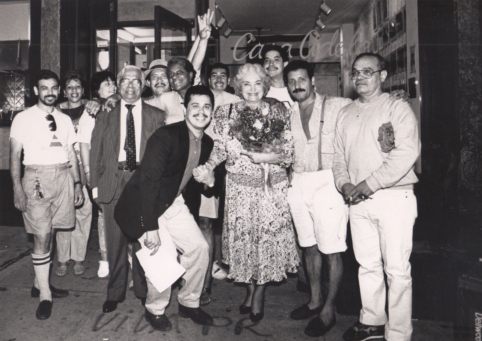 Lolita Lebrón at Casa Adela. Muralist Freddy Hernandez ( La Plaza Cultural Mural ) is at right—with mustache and wearing shorts.   Photo © Marlis Momber