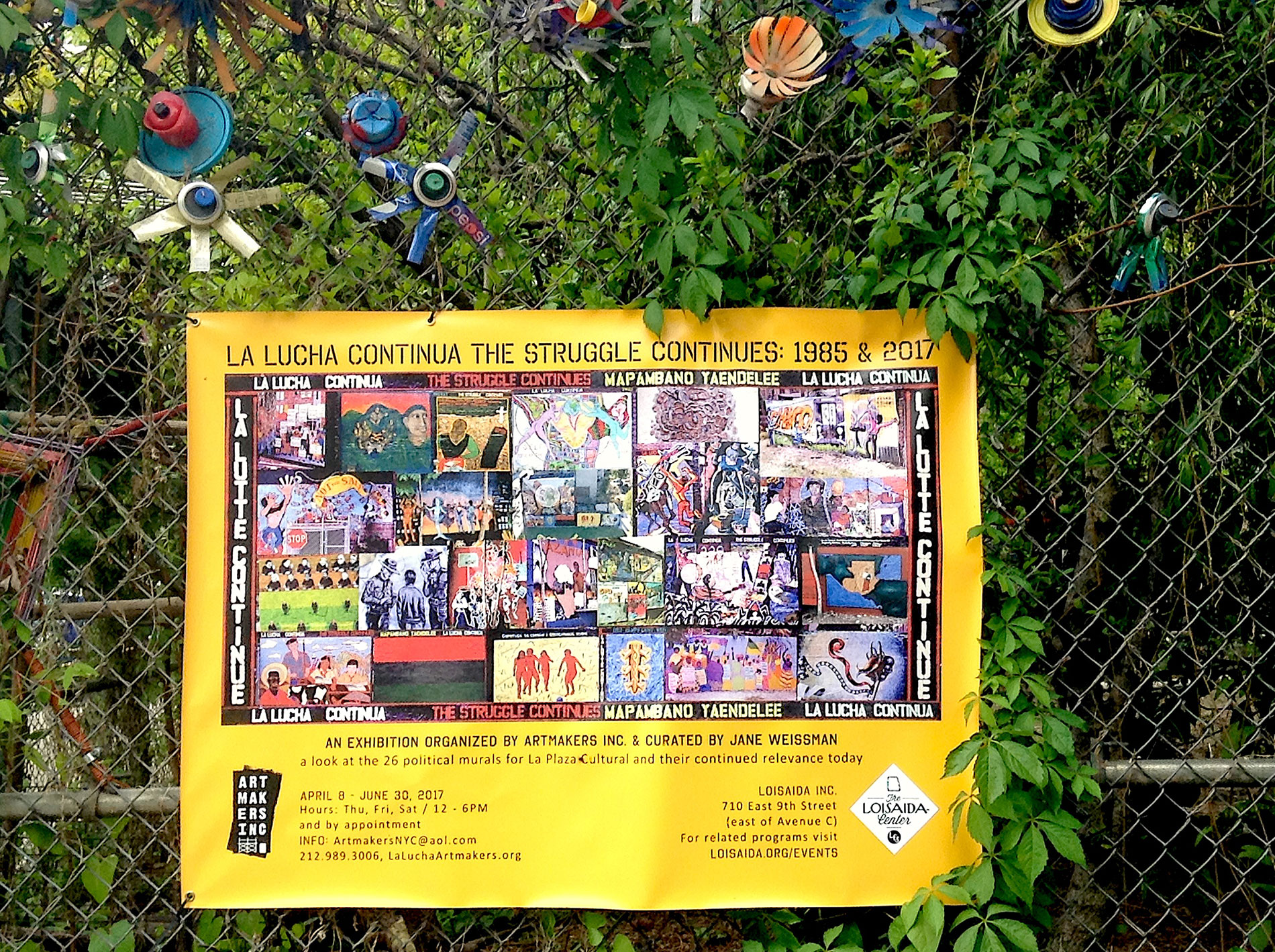 Exhibition banner on the fence of La Plaza Cultural   Photo © Jane Weissman