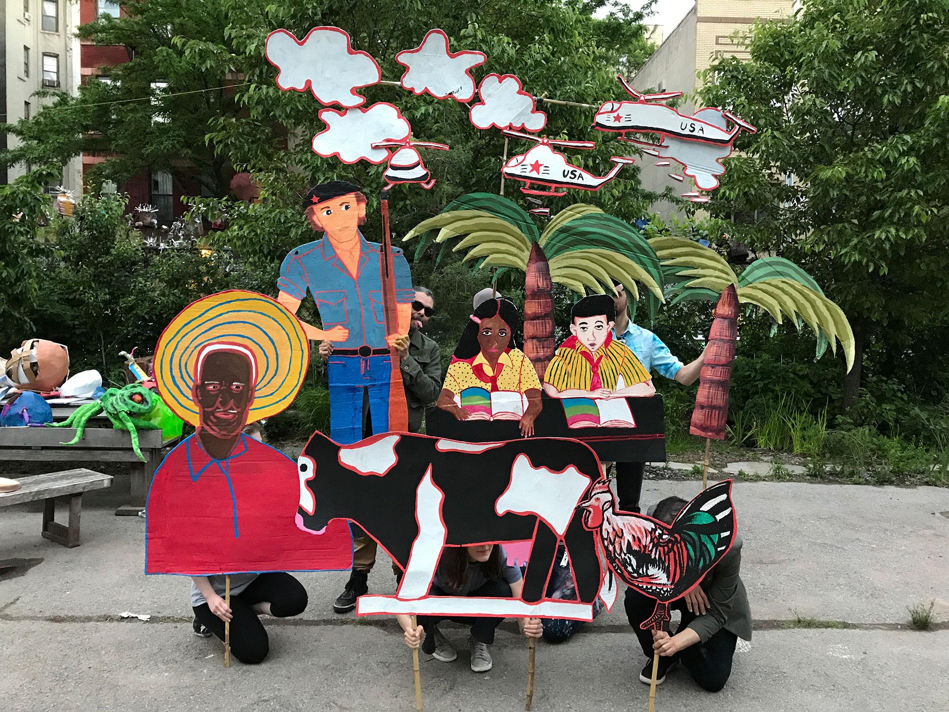 Adam Ende's puppets inspired by Karin Battin's mural  Nicaragua.    Photo © Jane Weissman