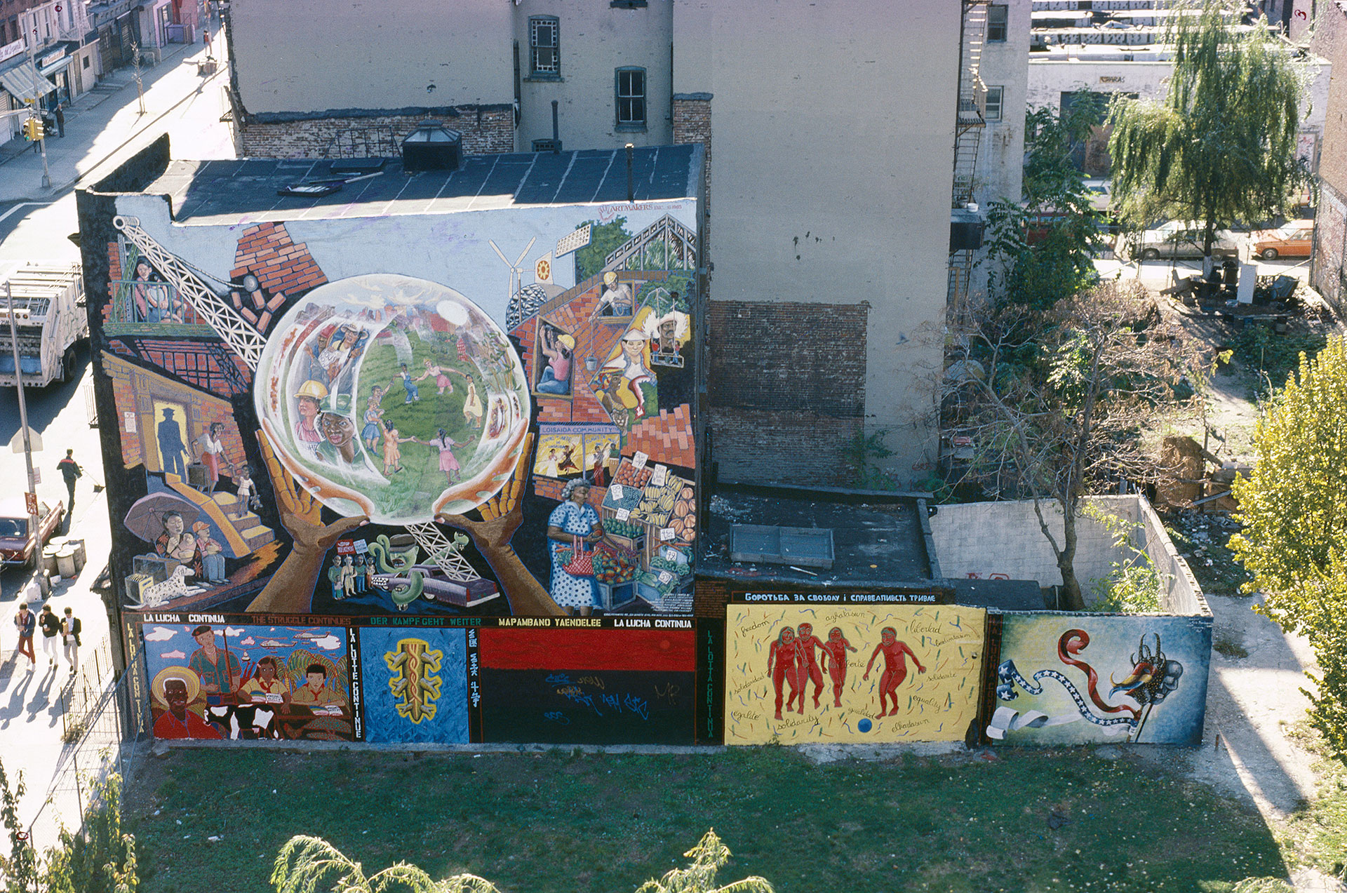 Above:  La Lucha Continua The Struggle Continues  collective mural. Below: individual murals by Karin Batten, Keith Christensen, Cliff Joseph, Camille Perrottet and Maria Dominguez  Photo © Estate of Eva Cockcroft