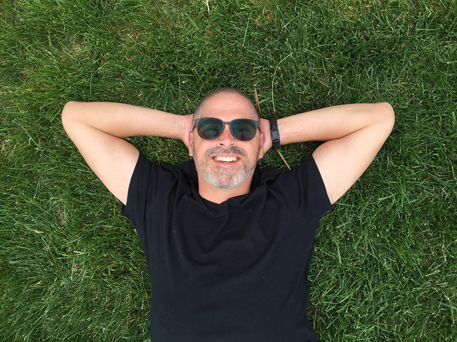 guy smiling in grass