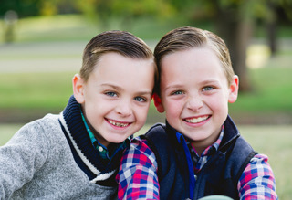 two brothers smiling outside
