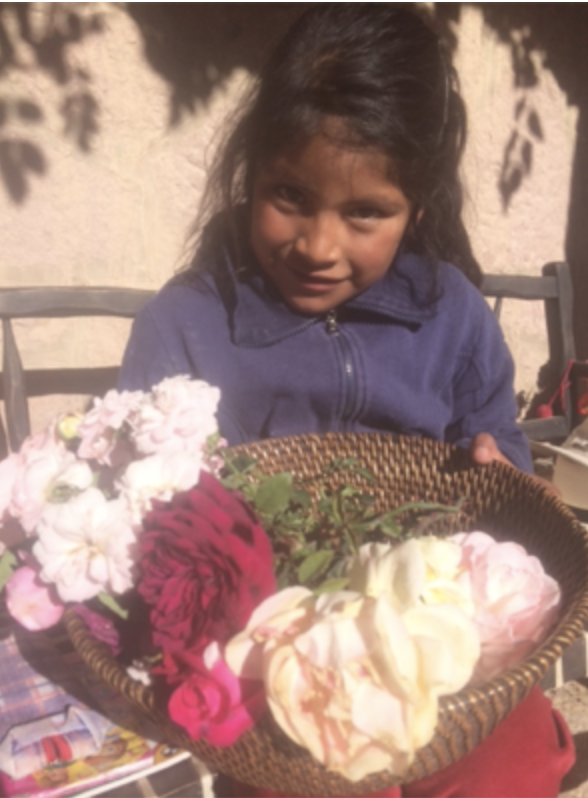 Mili with a basket of flowers