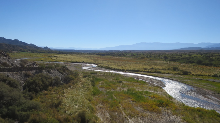 The Calchaquí River winds down the broad valley from the Nevado de Cachi.