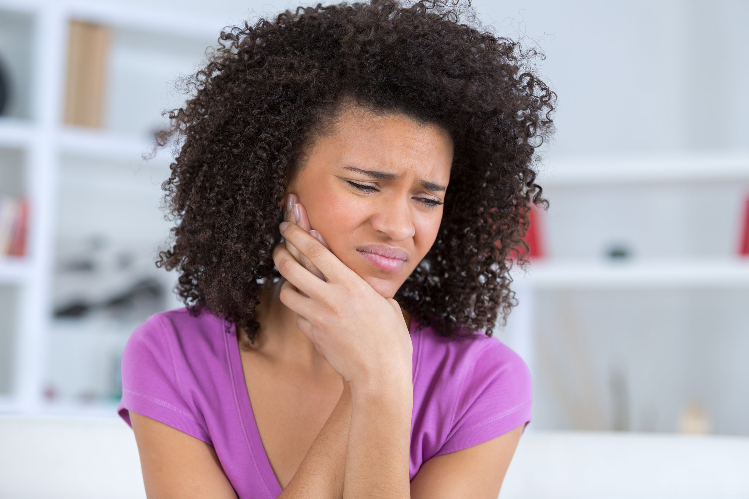 TMJ and Facial Pain - Individuals with a TMJ disorder may experience a variety of symptoms, such as earaches, headaches and limited ability to open their mouth.