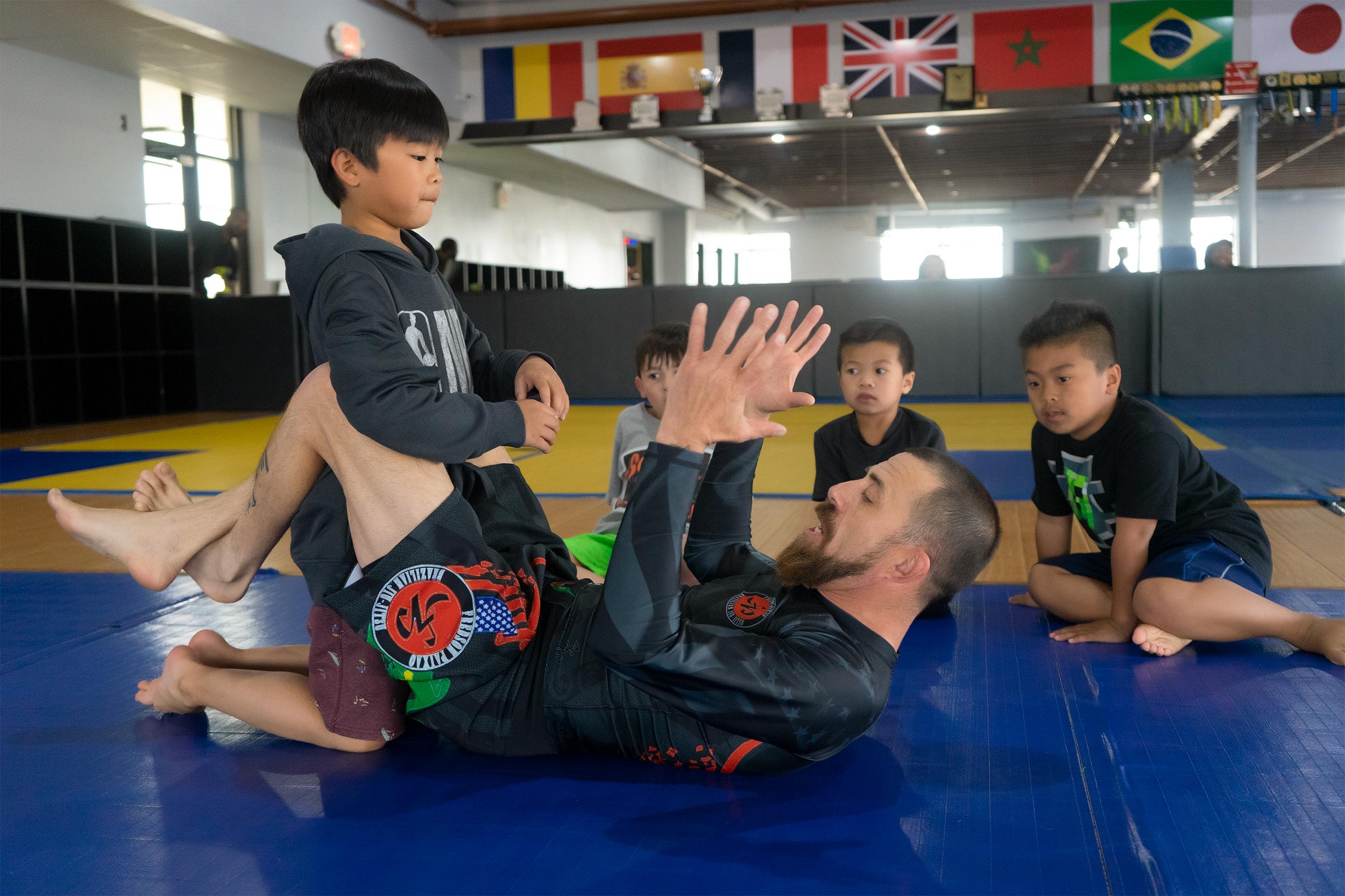 Jiu Jitsu Teacher and Kids.jpg