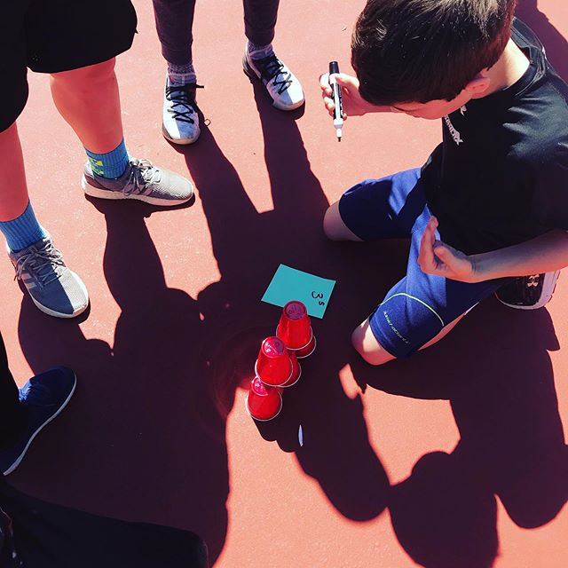 A beautiful day for the opening ceremonies of our computation olympics.  Here our competitors are racing to be the first to 'stack a tower of powers.' The team in the photo is about to write the value of three to the fifth power on the top of their five-cup tower.  #yunderstandmath #iteachmath #learnoutside #visualmath #teach