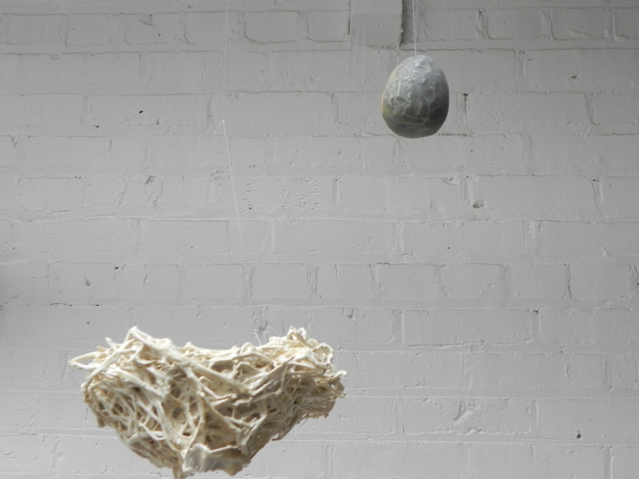 ceramic sculpture  suspended from ceiling  approx  24x 18 inches installed  october 2009