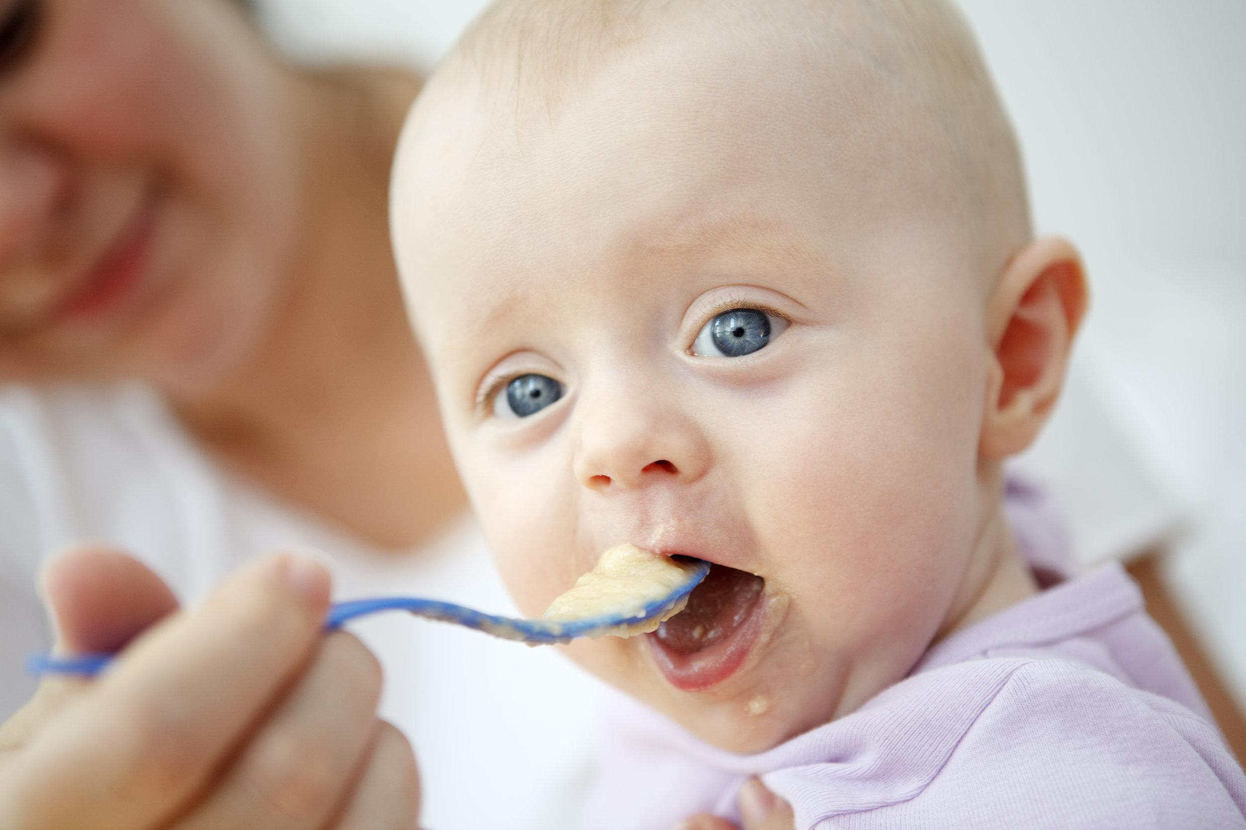 Mother-feeding-her-baby-182922928_3867x2578.jpeg