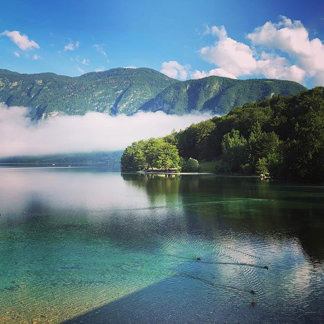 Morning sun on Lake Bohinj, #Slovenia #travel #production #clouds #mountains #water #blue #nature