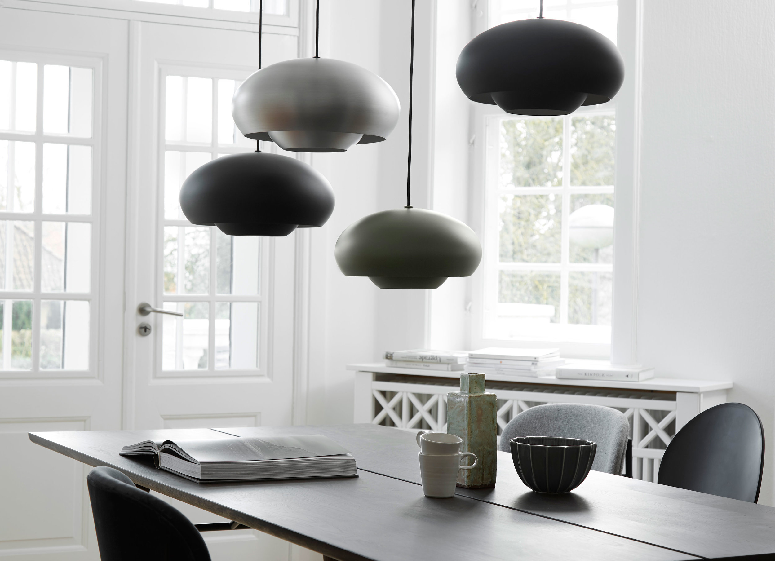 """""""Philip Bro is the designer behind this beautiful lamp from Frandsen Retail. With its elliptical shape and simple shade, it elegantly embodies the classic trend in today's interiors.""""   READ"""