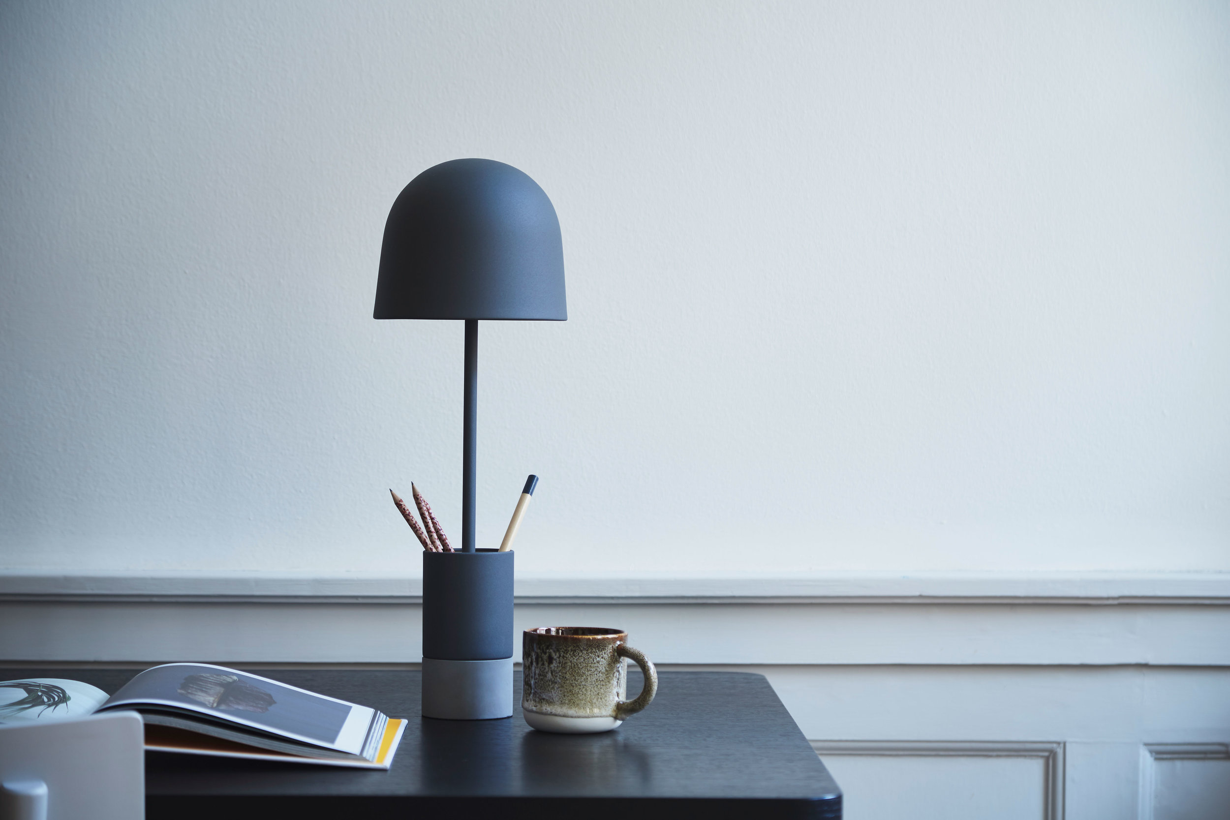 """""""The Pen lamp is a charming and practical little addition to your home. It emits a soft light, charms with its distinctive shape and keeps your favourite desk tools organized.""""   READ"""