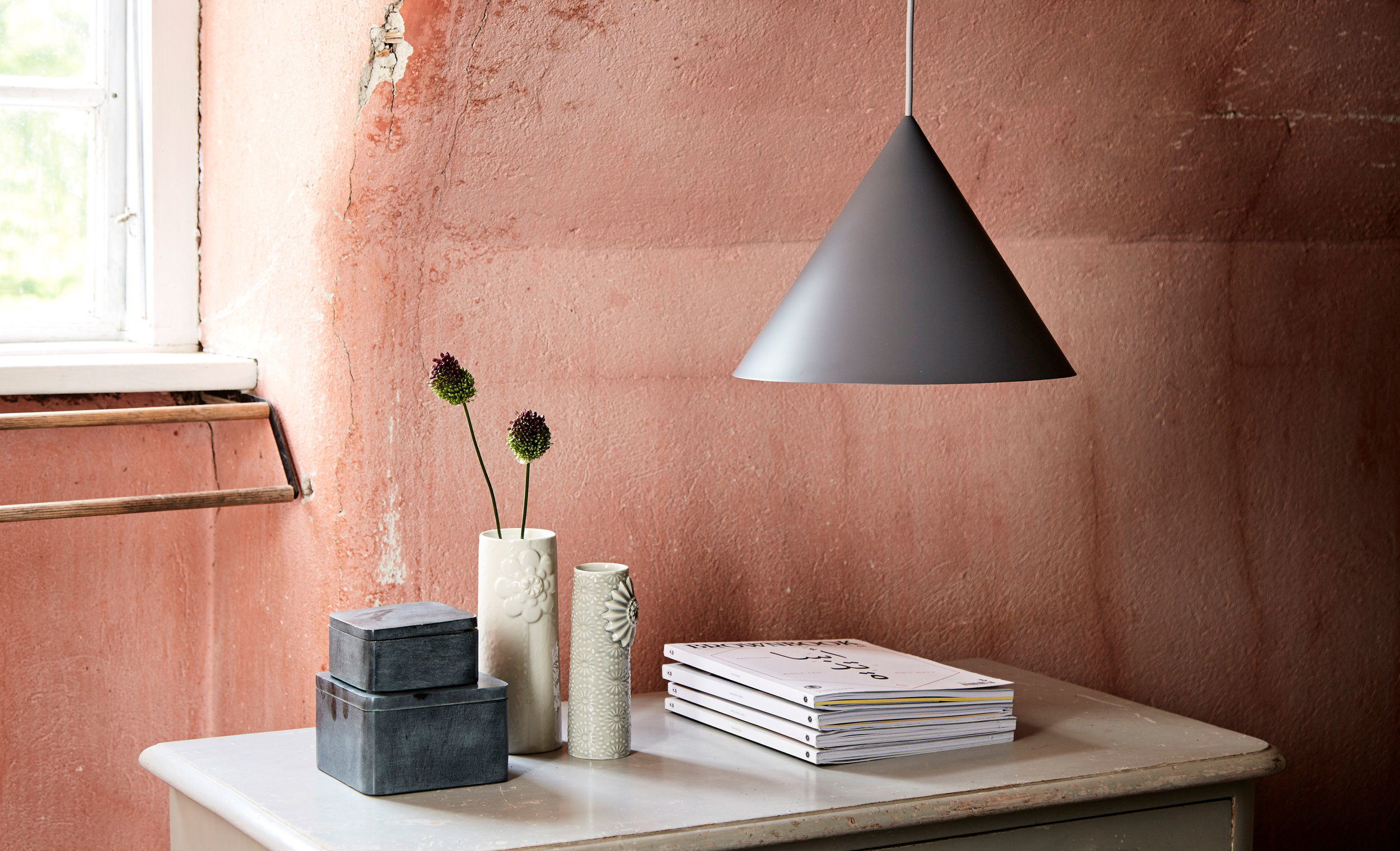 """""""The cone is a classic geometric shape like the cube and the sphere. Vilhelm Lundstrøm plays with these forms in his paintings of minimalist tableaux, and now the cone has become the principle element in the Benjamin lamp series from Frandsen Retail. All models feature a distinctive conical shade, a sharp graphic design and a monochromatic look.""""   READ"""