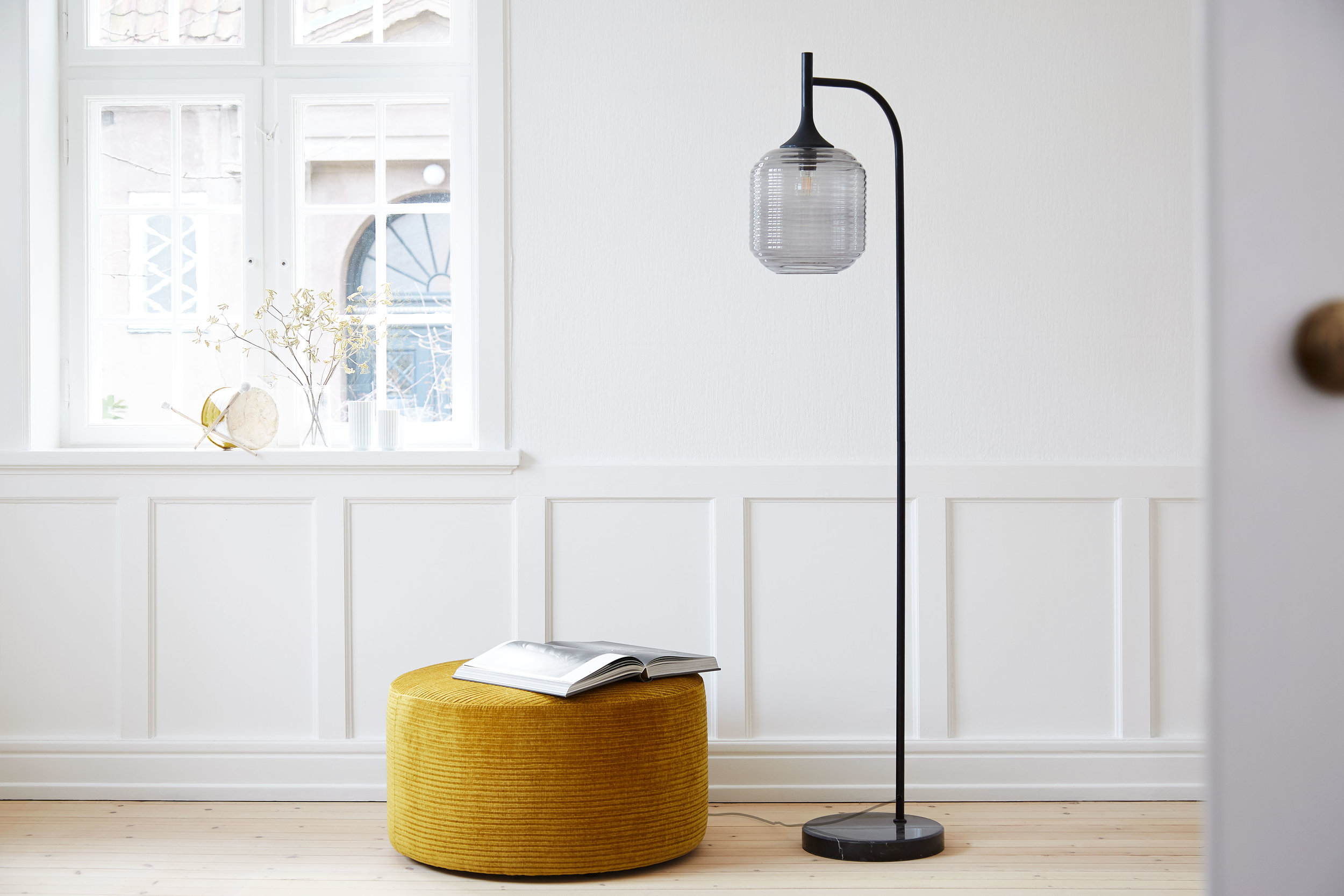 Floor lamp with glass shade and rubber wood top. Dimensions: H177 cm | ø26 cm Variants: Smoke glass Designer: Guillaume Delvigne    MORE