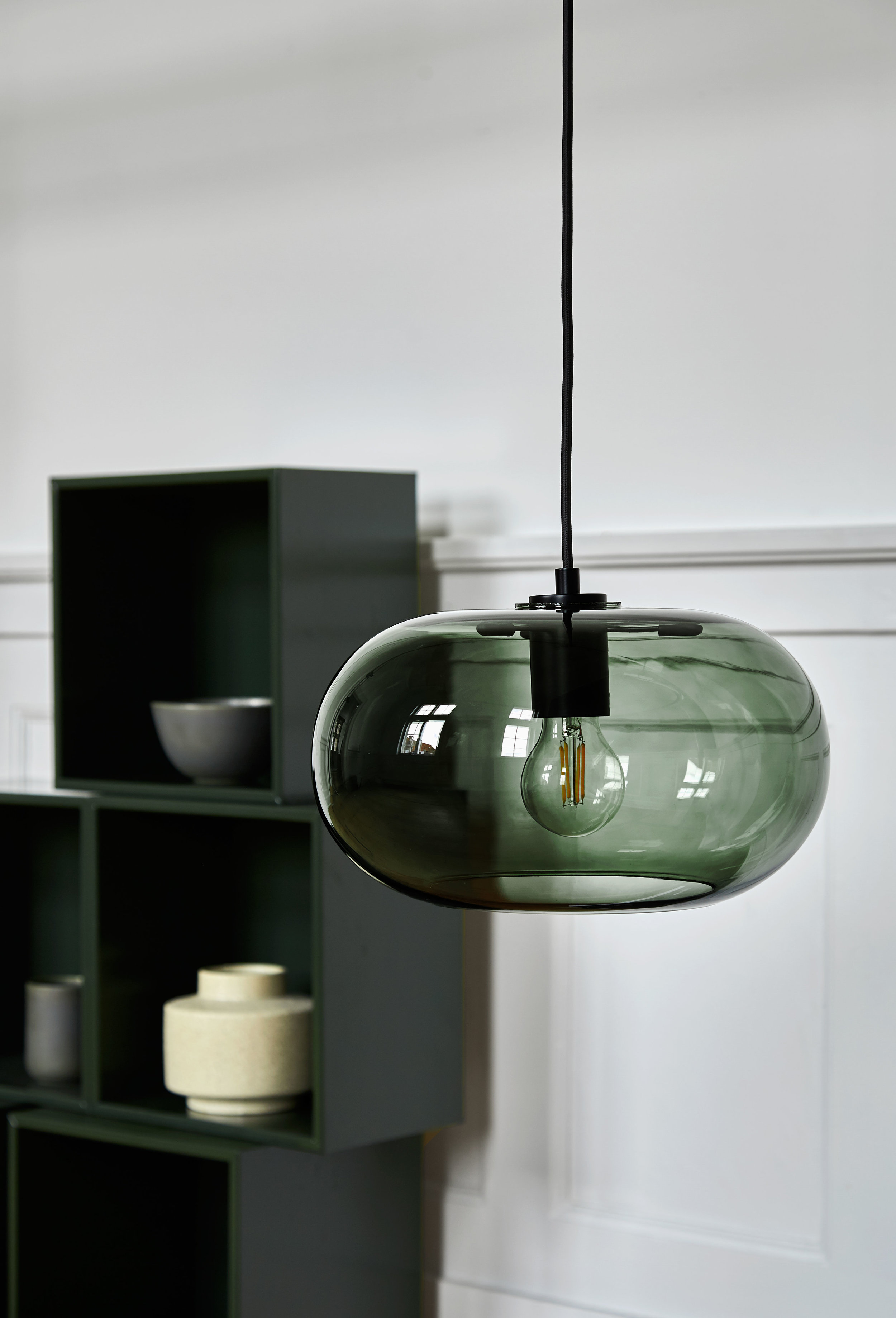 Glass pendant with fabric cord. Dimensions: ø30 cm Variants: Bronze | Smoke | Green Designer: Benny Frandsen    MORE