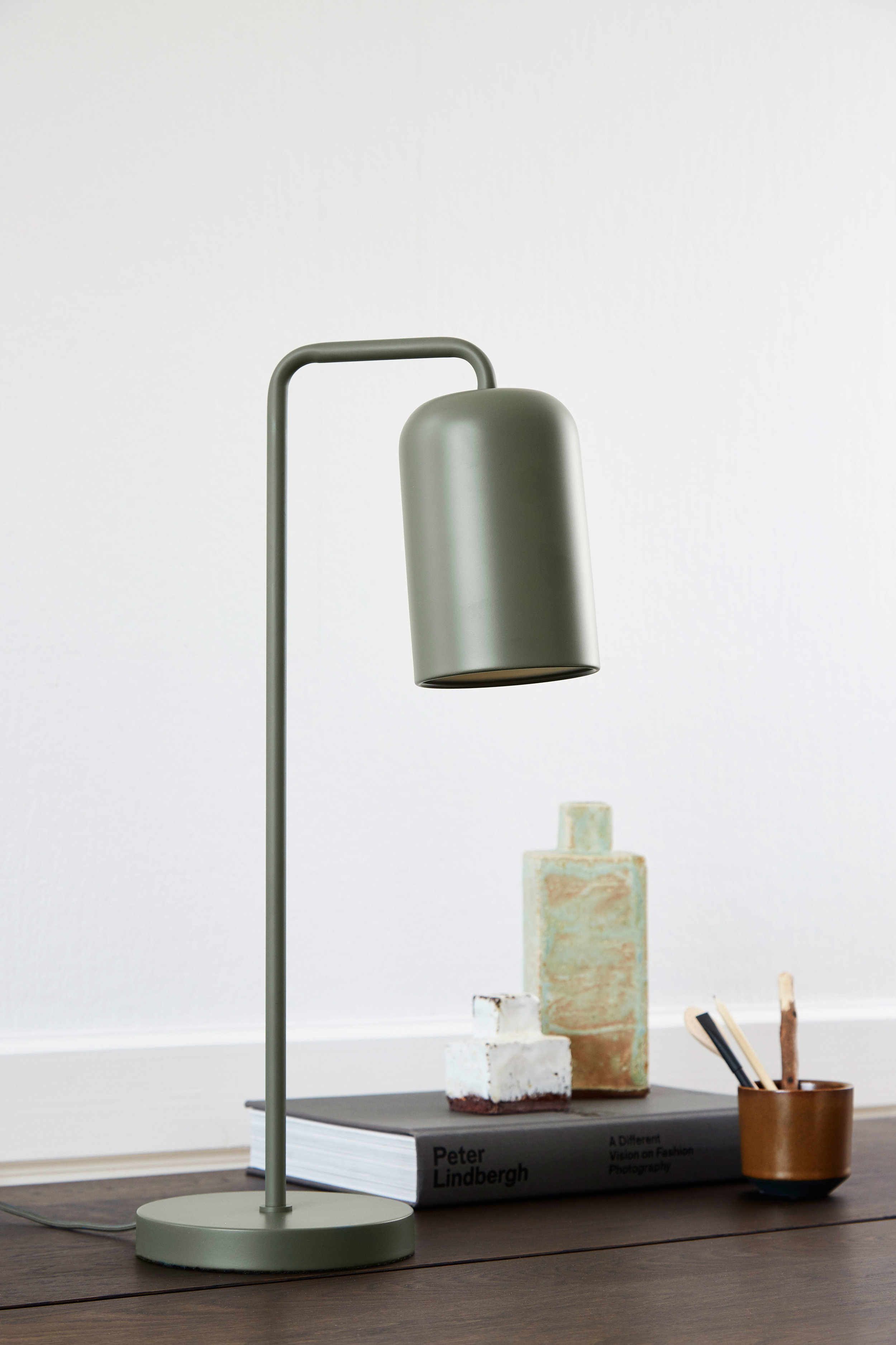 Metal table lamp with fabric cord. Dimensions: H56 cm | ø11 cm Variants: Black | Green | Chrome    MORE