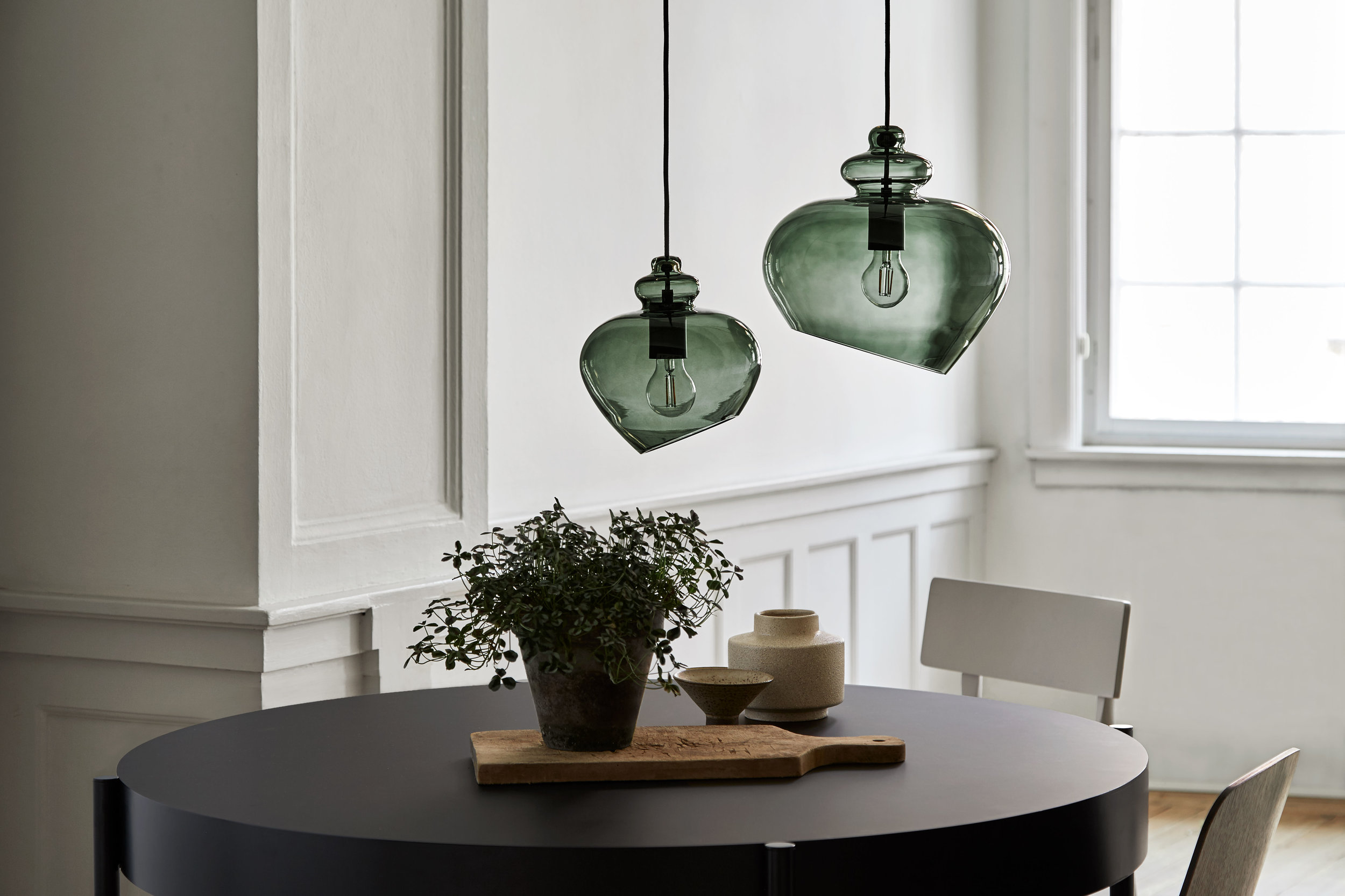 Glass pendant with black fabric cord. Dimensions: ø30 cm Variants: Bronze & Copper socket | Smoke & Black socket | Bronze & Black socket | Green & Black socket Designer: Frandsen Design Studio    MORE
