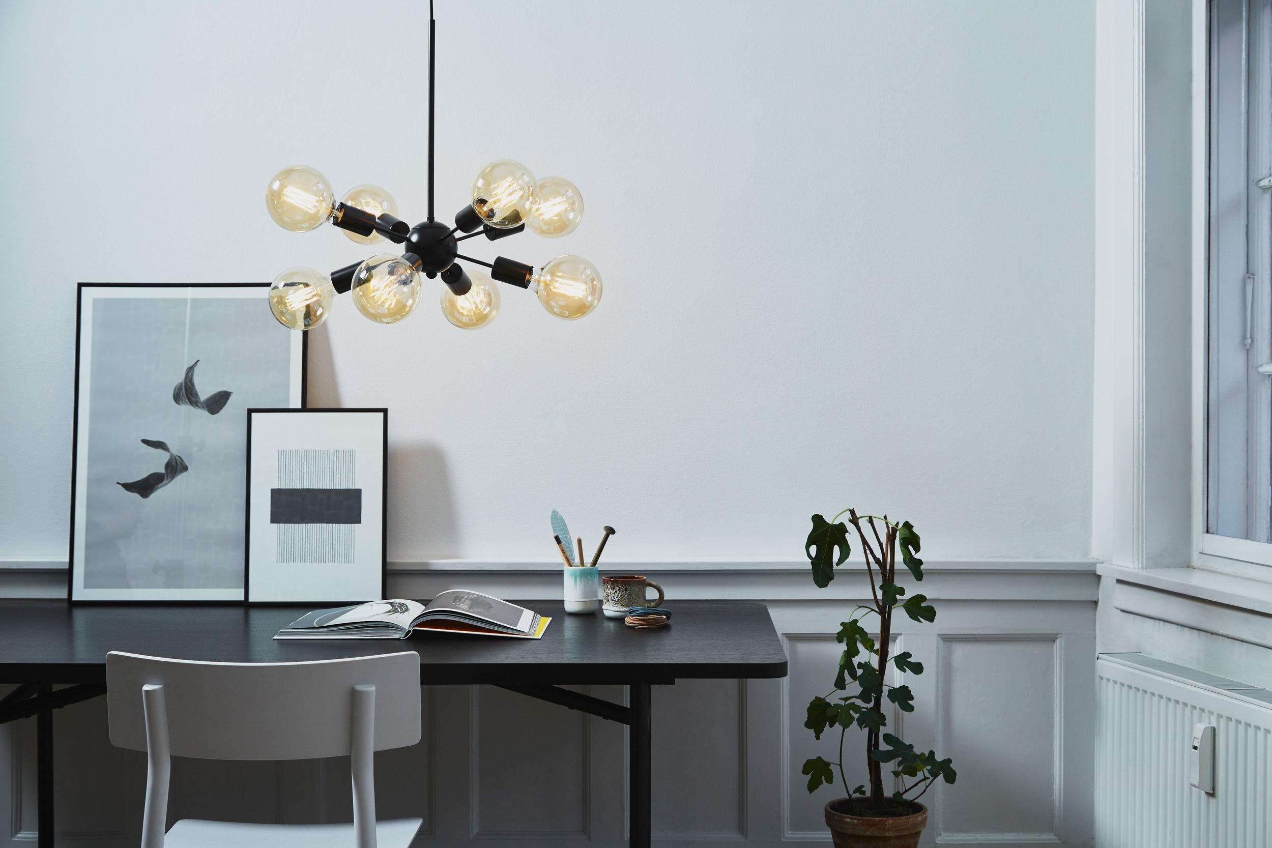 Chandelier with 8 arms. Dimensions: ø38 cm | H48 cm | Arm: L15 cm Variants: Copper | Black Designer: Frandsen Design Studio    MORE