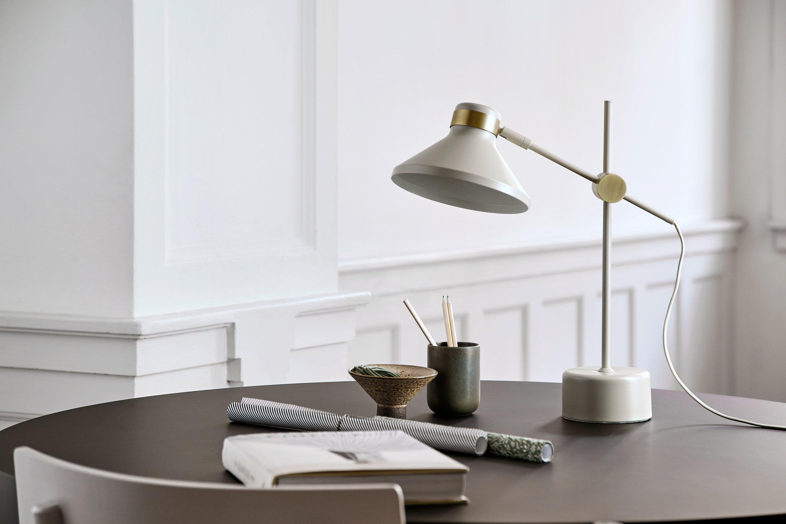 Table lamp with fabric cord. Dimensions: H44 cm | Shade: ø19 cm Variants: Black | Taupe | Dark Blue Designer: Frandsen Design Studio    MORE
