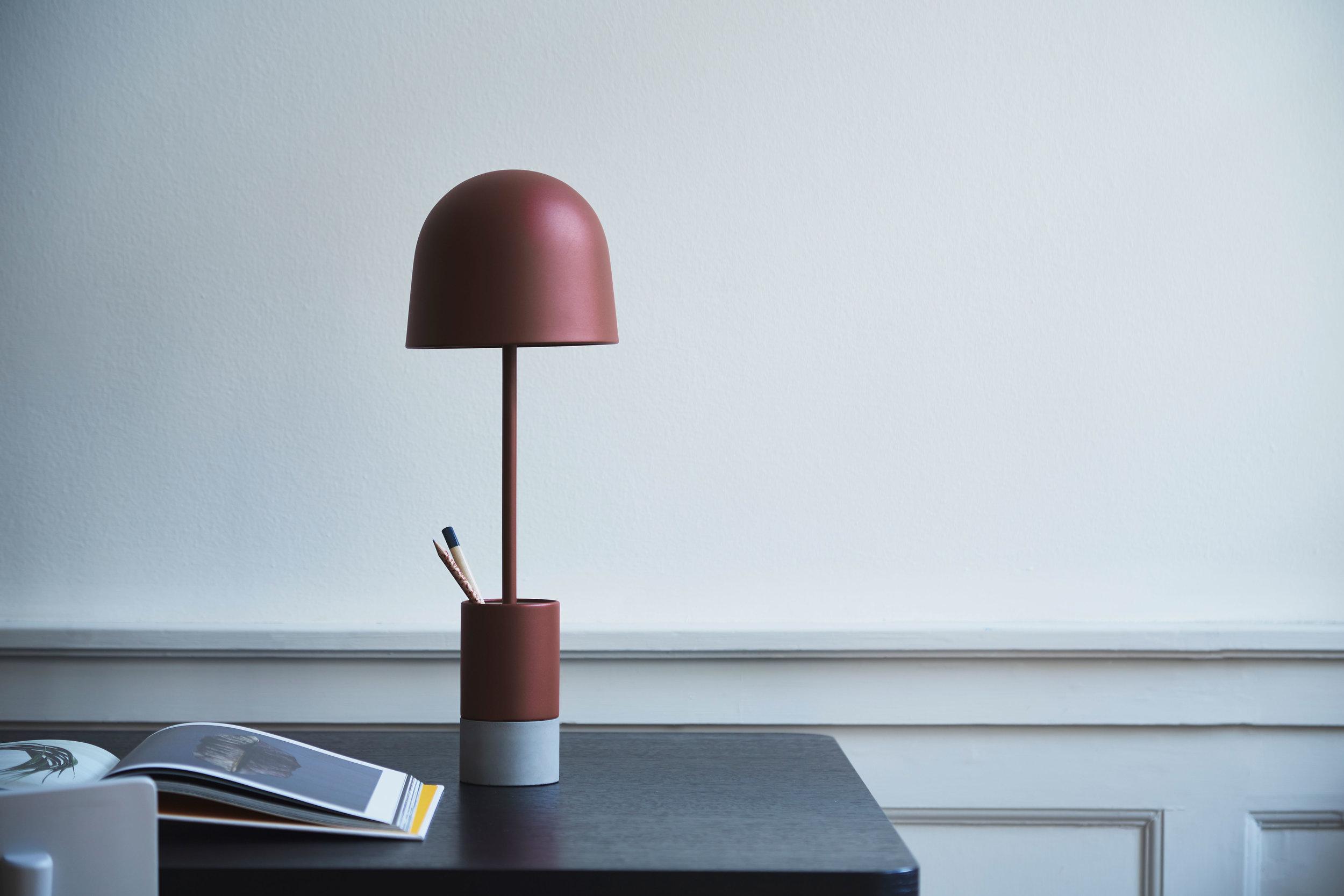 Desk lamp. Dimensions: H49 cm | Shade: ø17 cm Variants: Dust rust structure | Dark grey structure Designer: Frandsen Design Studio    MORE