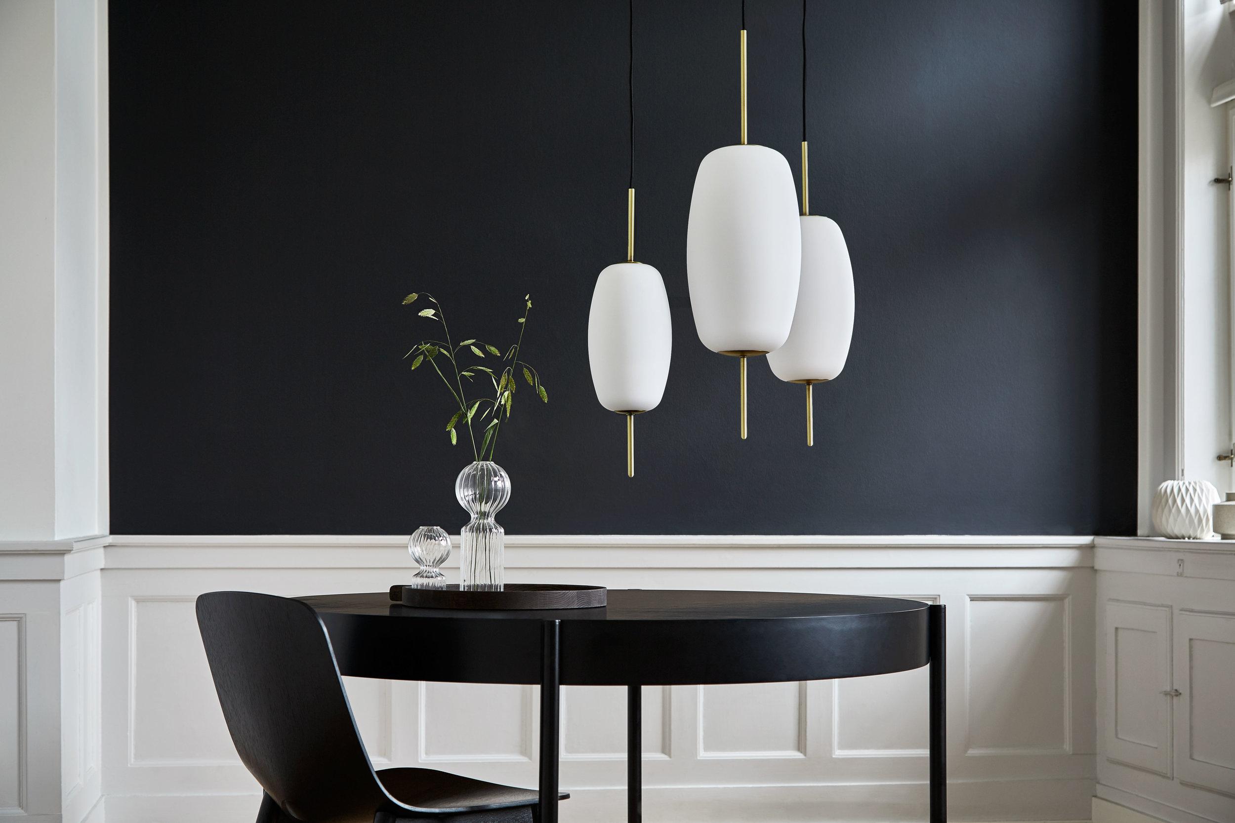 Metal floor lamp. Dimensions: Available in ø16, ø20 & ø22 Variants: Opal white glass Designer: Frandsen Design Studio    MORE