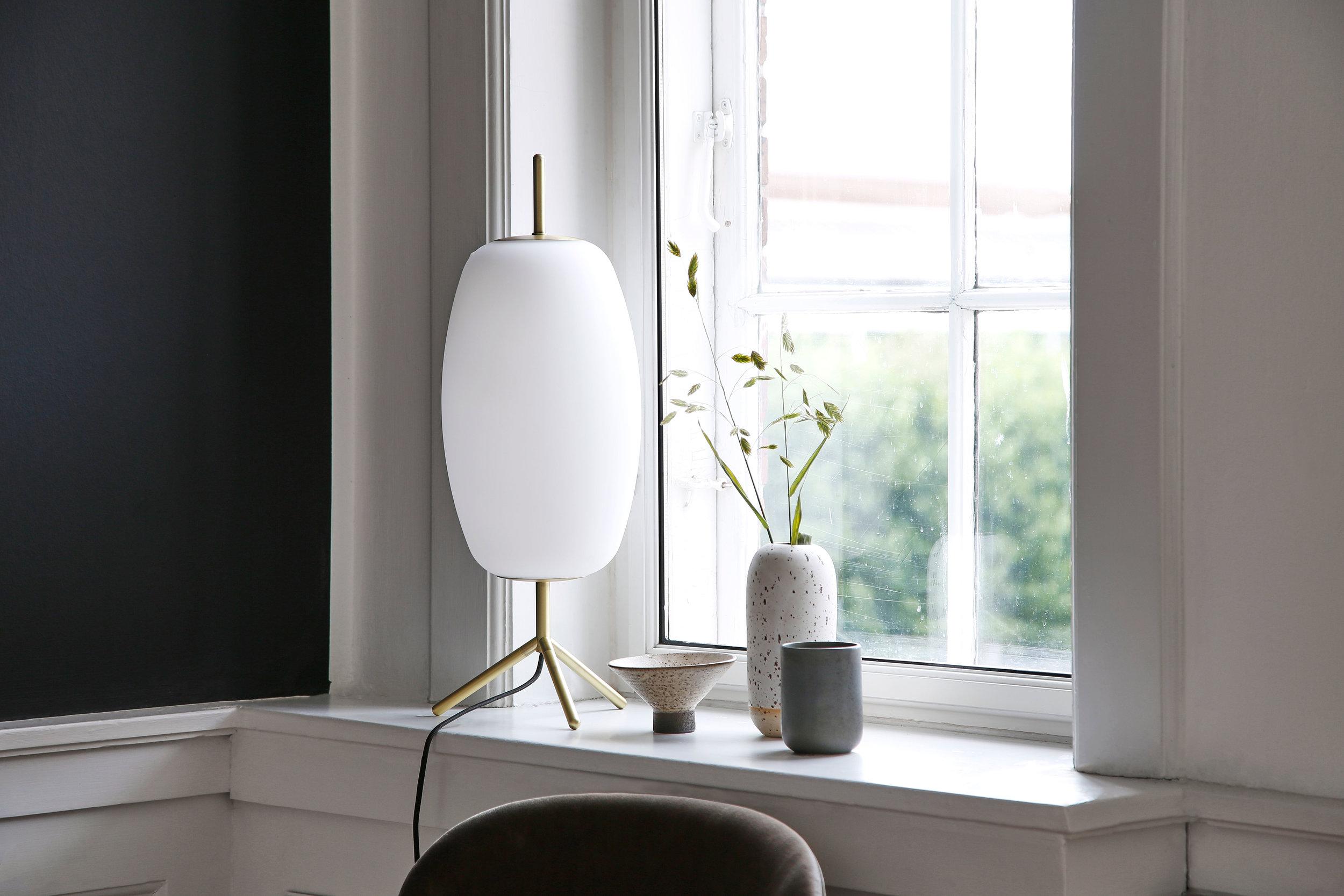 Glass table lamp. Dimensions: H56 cm | Shade: ø20 cm Variants: Opal white glass Designer: Frandsen Design Studio    MORE