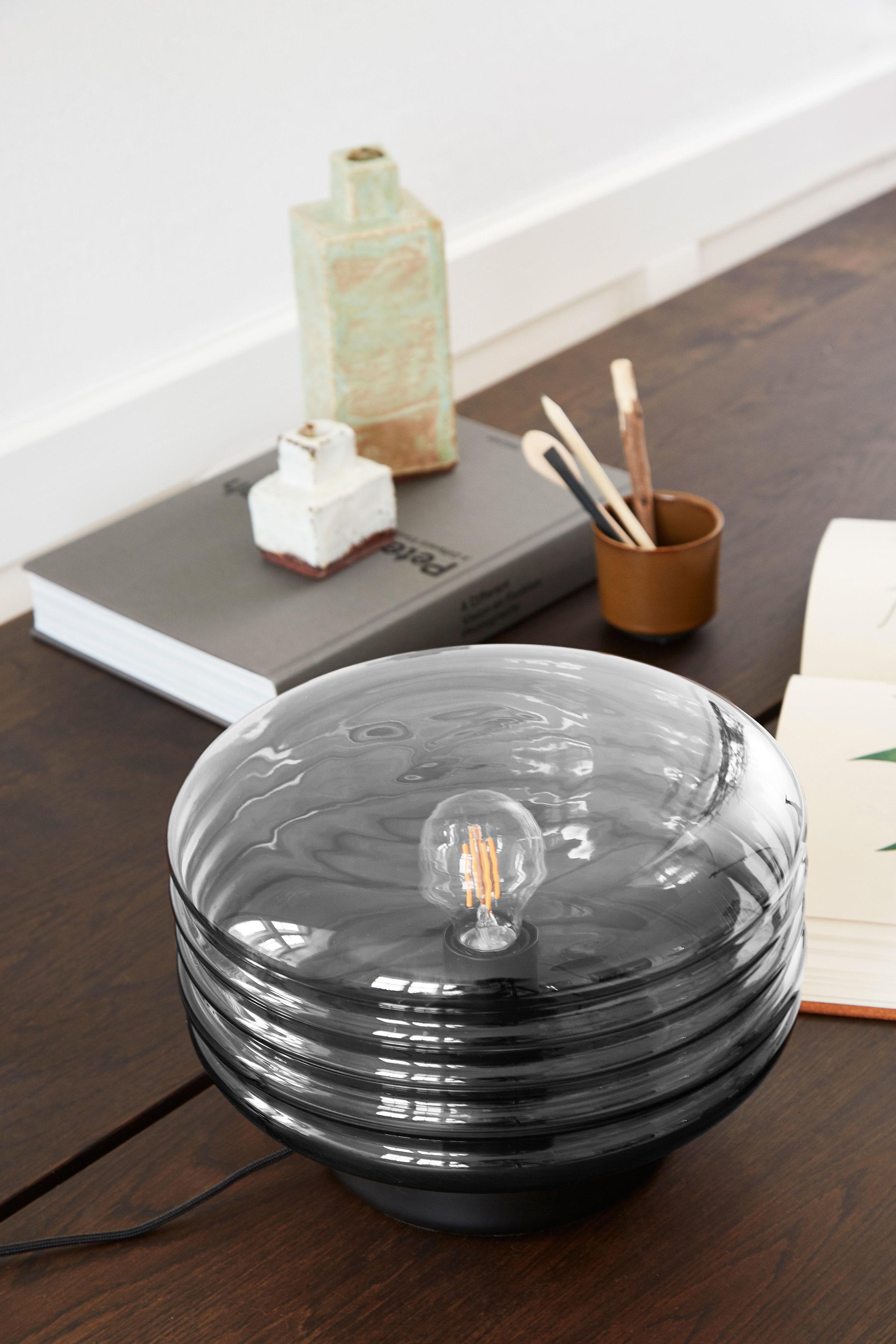 Glass table lamp. Dimensions: ø30 cm | H25 cm Variants: Smoke glass Designer: Frandsen Design Studio    MORE