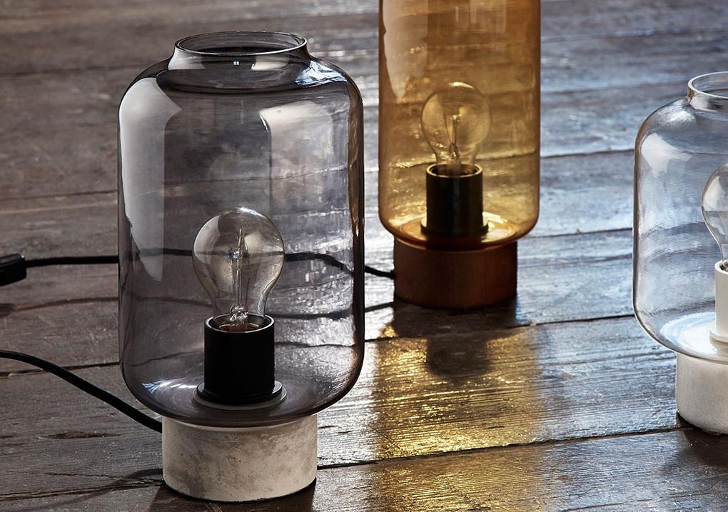 Table lamp with glass. Dimensions: H27 cm | ø16 cm Variants: Mustard Brown | Smoke Designer: Frandsen Design Studio    MORE