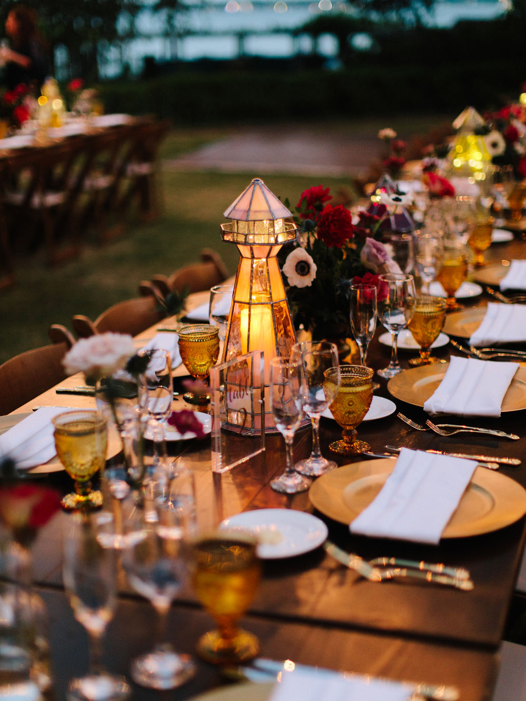 outdoor-recepition-decorations-gold-chargers-jacksonville wedding-planner.jpg