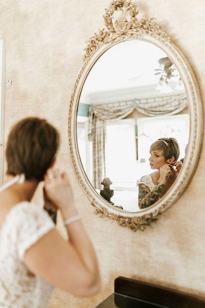 3 - Southern Charm Events – Club Continental – Club Continental Wedding – Jacksonville wedding – Jacksonville wedding planner -  tattooed bride - bride looking in mirriw.jpg