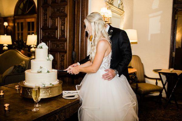 14 - Southern Charm Events – Epping Forest Yacht Club wedding – Jacksonville wedding planner – Jacksonville weddings - cutting wedding cake.jpg