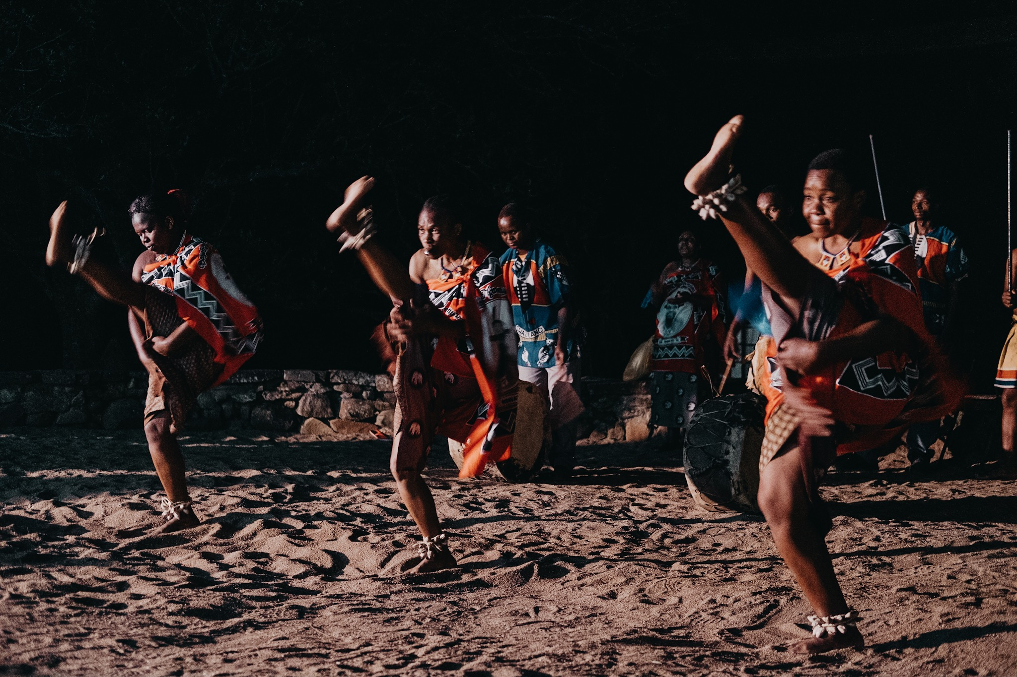 Local Swaziland dancers perform at the Mlilwane Wildlife Sanctuary around the campfire.