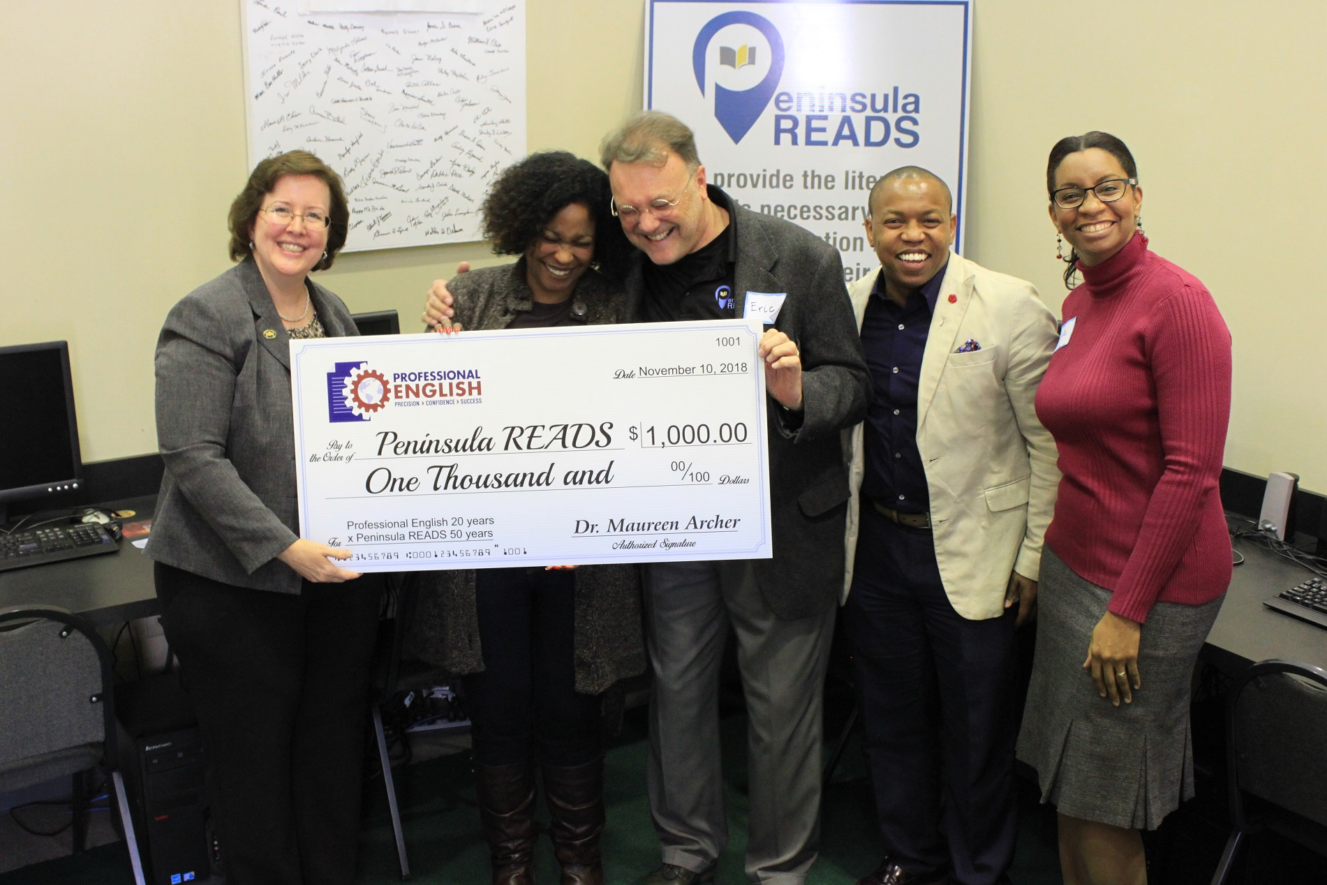 Check Presentation to Peninsula Reads.jpg