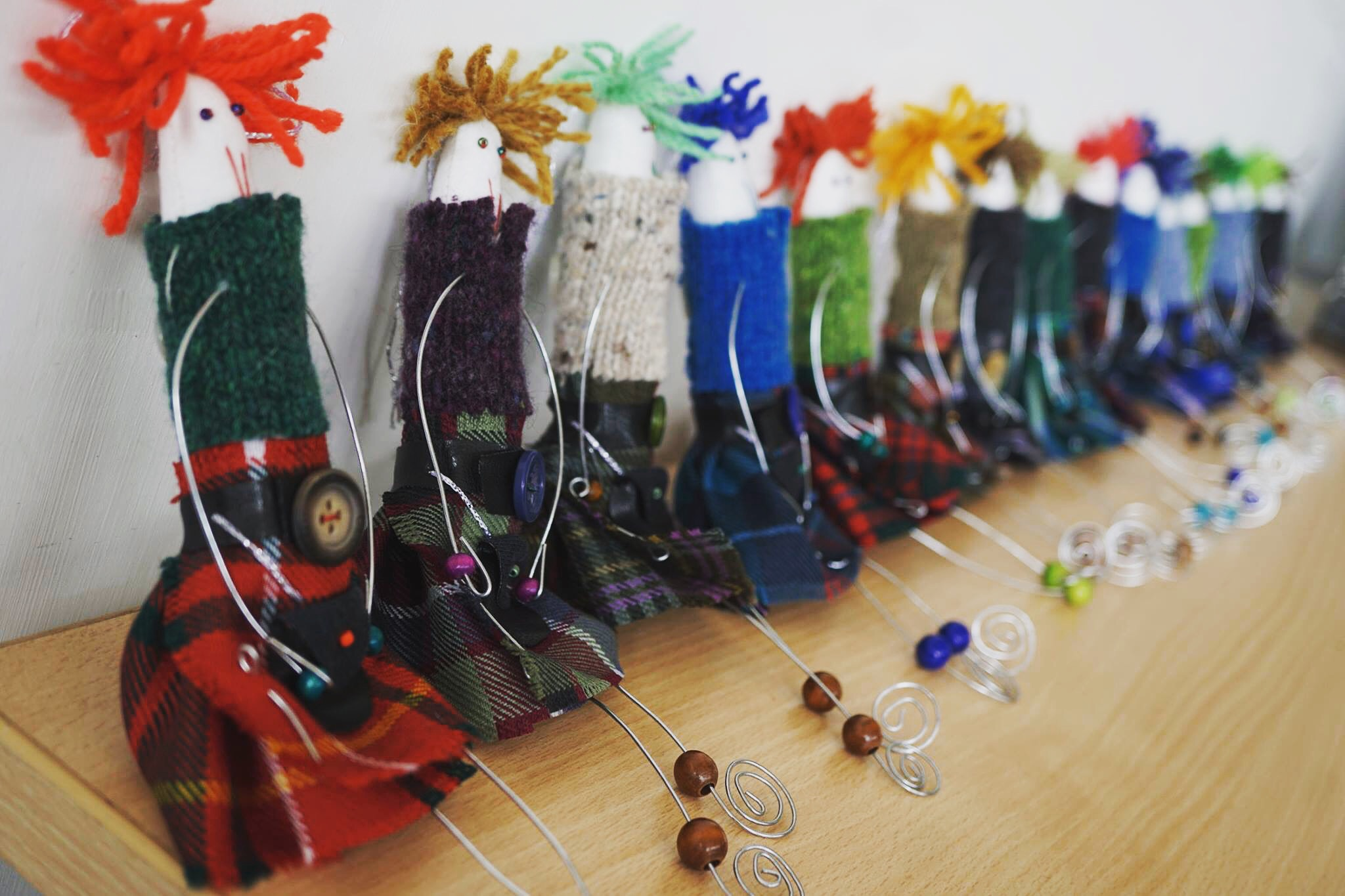 Cannie Men - The Cannie Men are decorative gifts. The Lads have little kilts, sporrans and wool jumpers . They each have their own Scottish name including Murdo, Hamish and Wild Willie and some mad hair. The Real Scotsmen have a few wee extras under their kilts!! again Commissions are welcome.Each wee man is unique and is lovingly made with locally sourced fabric, yarns, buttons and beads with metal arms and legs. They can sit or be hung up around the house. Tell them your wishes and perhaps they will come true.(Please note these are decorative and not toys)