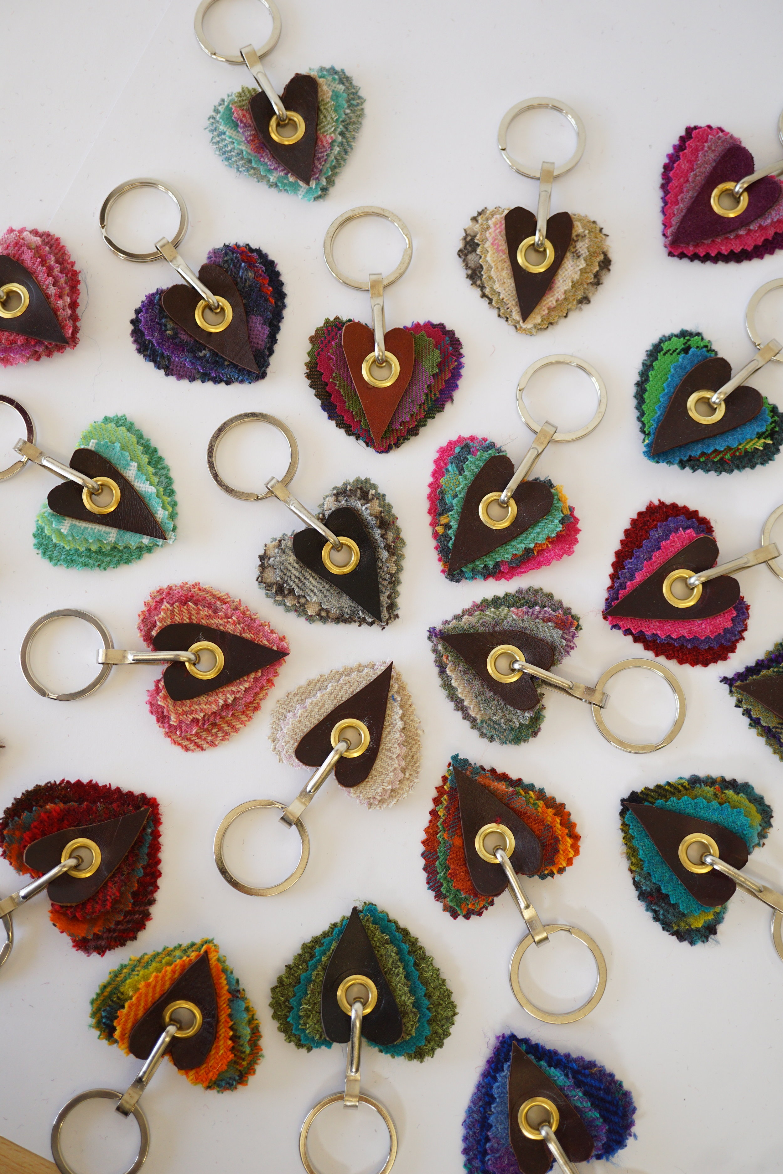 Keyrings - The Keyrings come as hearts or rectangle layers of fabric with upcycled leather and strong quality metal wear. They come packaged on a card with an envelope and a wee message about how precious your keys. They come packaged in a cellophane envelope. The fabrics are all locally sourced tartan and tweeds.