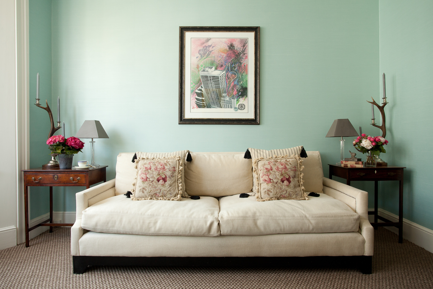 photograph of sofa in living room, green walls